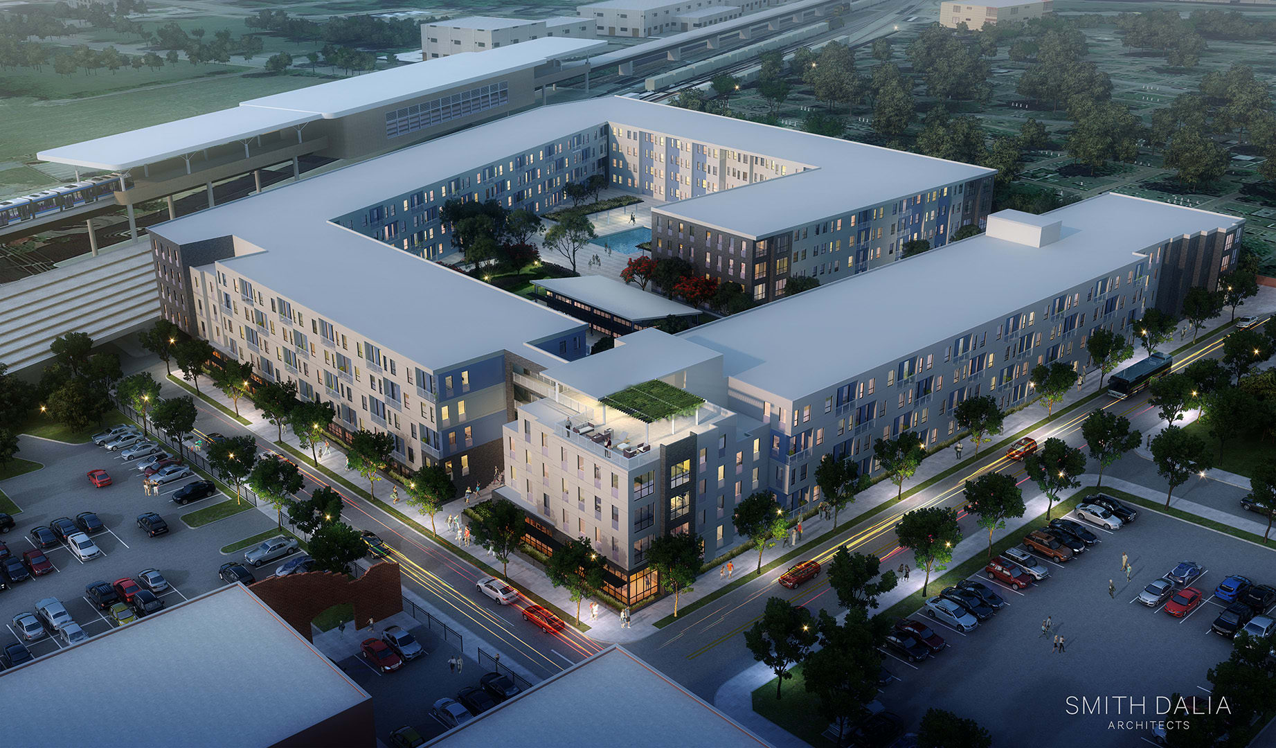 An aerial rendering of the proposed development shows how new construction would fit onto existing surface parking.