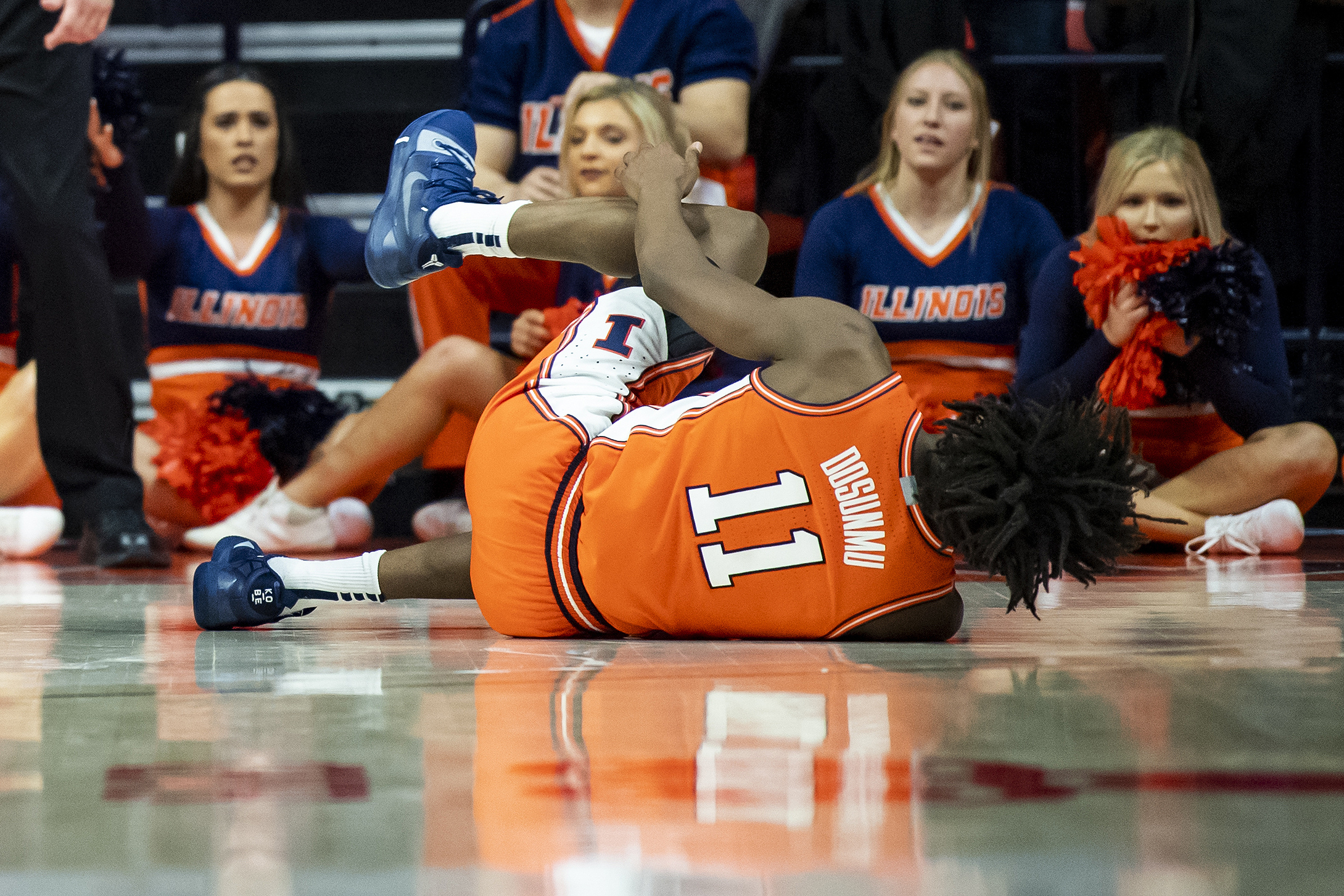 Illinois Fighting Illini guard Ayo Dosunmu reacts after a last second game injury against the Michigan State Spartans at State Farm Center.