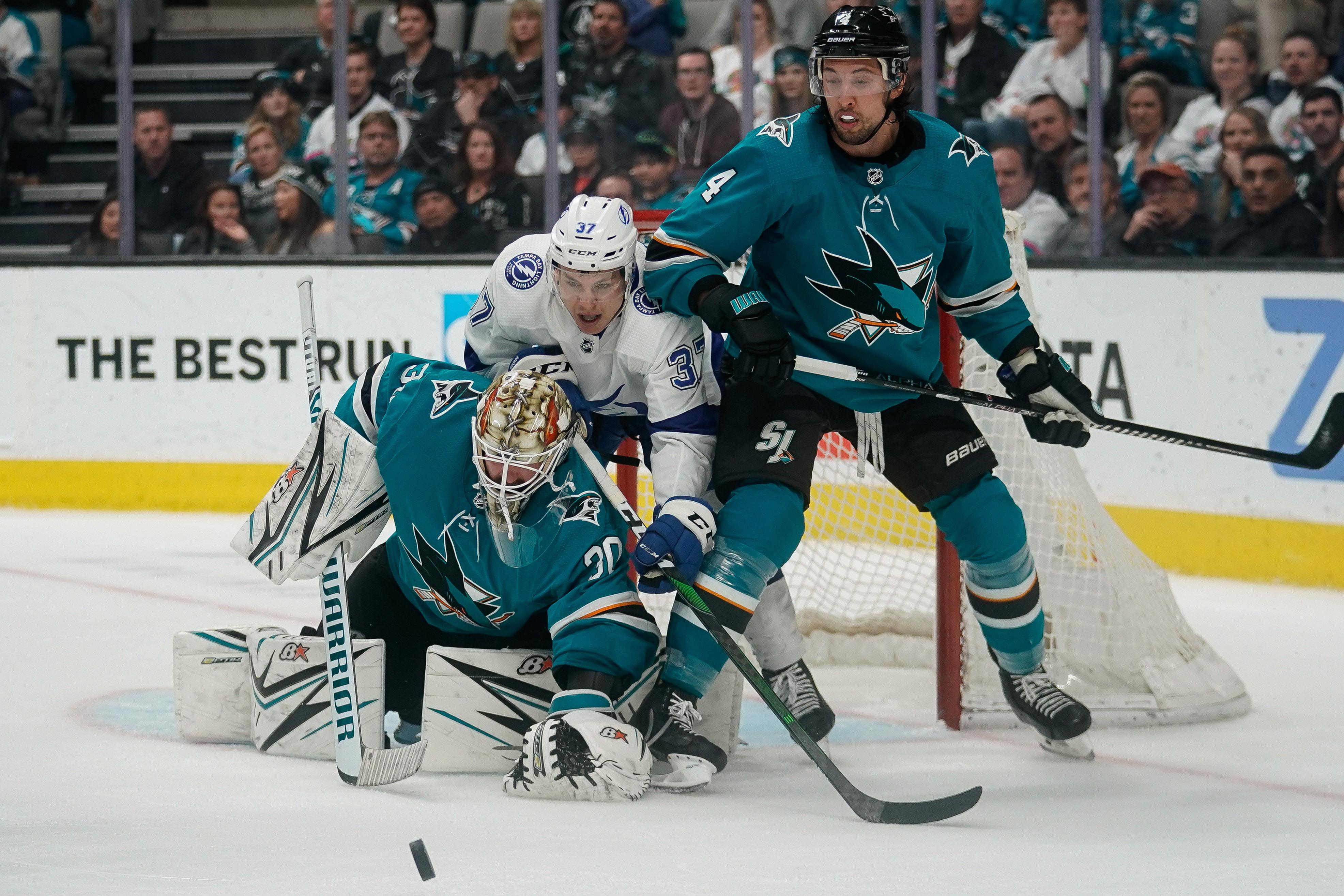 Feb 1, 2020; San Jose, California, USA; San Jose Sharks goaltender Aaron Dell (30) and defenseman Brenden Dillon (4) defend the goal from Tampa Bay Lightning center Yanni Gourde (37) during the third period at SAP Center at San Jose.