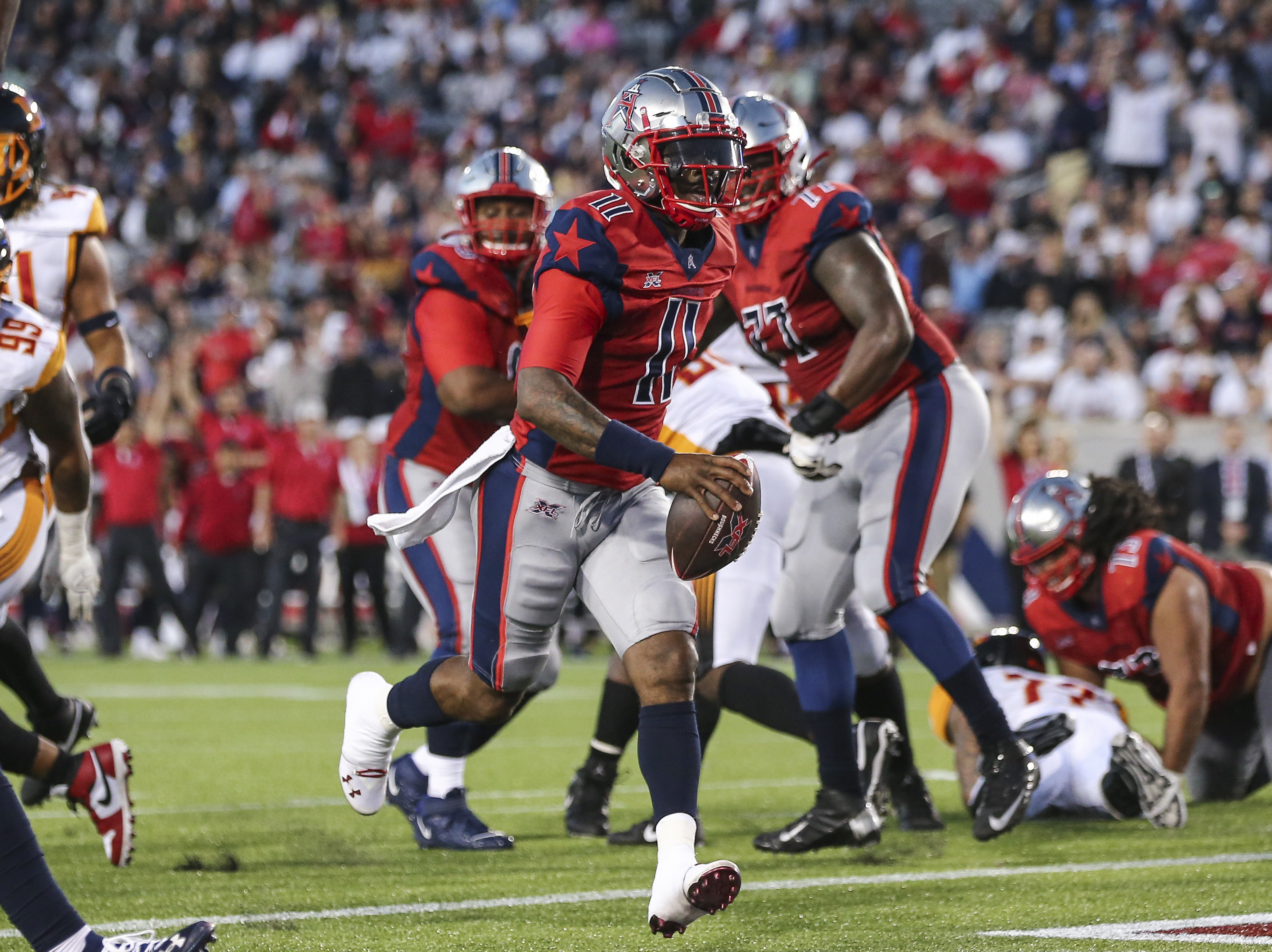 Houston Roughnecks quarterback P.J. Walker runs with the ball to score a two point conversion during the third quarter against the Los Angeles Wildcats in a XFL football game at TDECU Stadium.