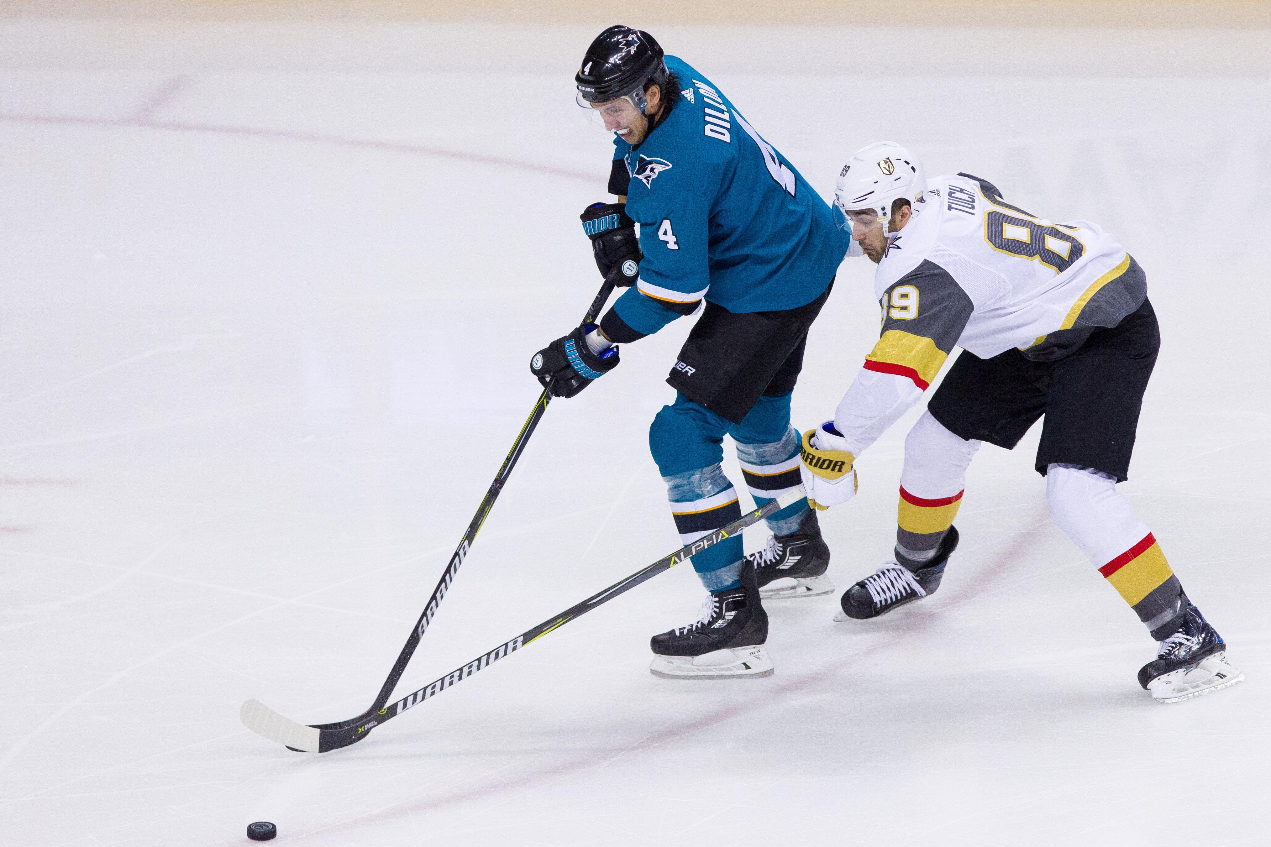Feb 8, 2018; San Jose, CA, USA; San Jose Sharks defenseman Brendan Dillon (4) battles for the puck against Las Vegas Knights right wing Alex Tuch (89) at SAP Center at San Jose. The Knights won 5-3.