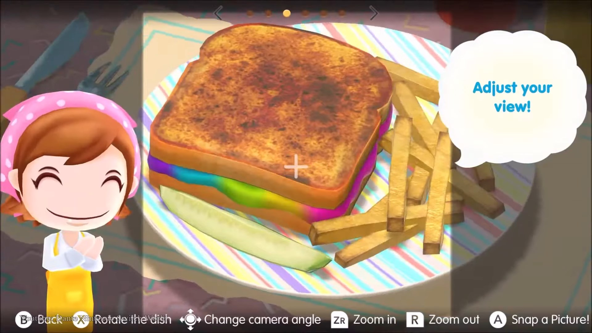 Mama stands happily next to a rainbow grilled cheese that's being photographed