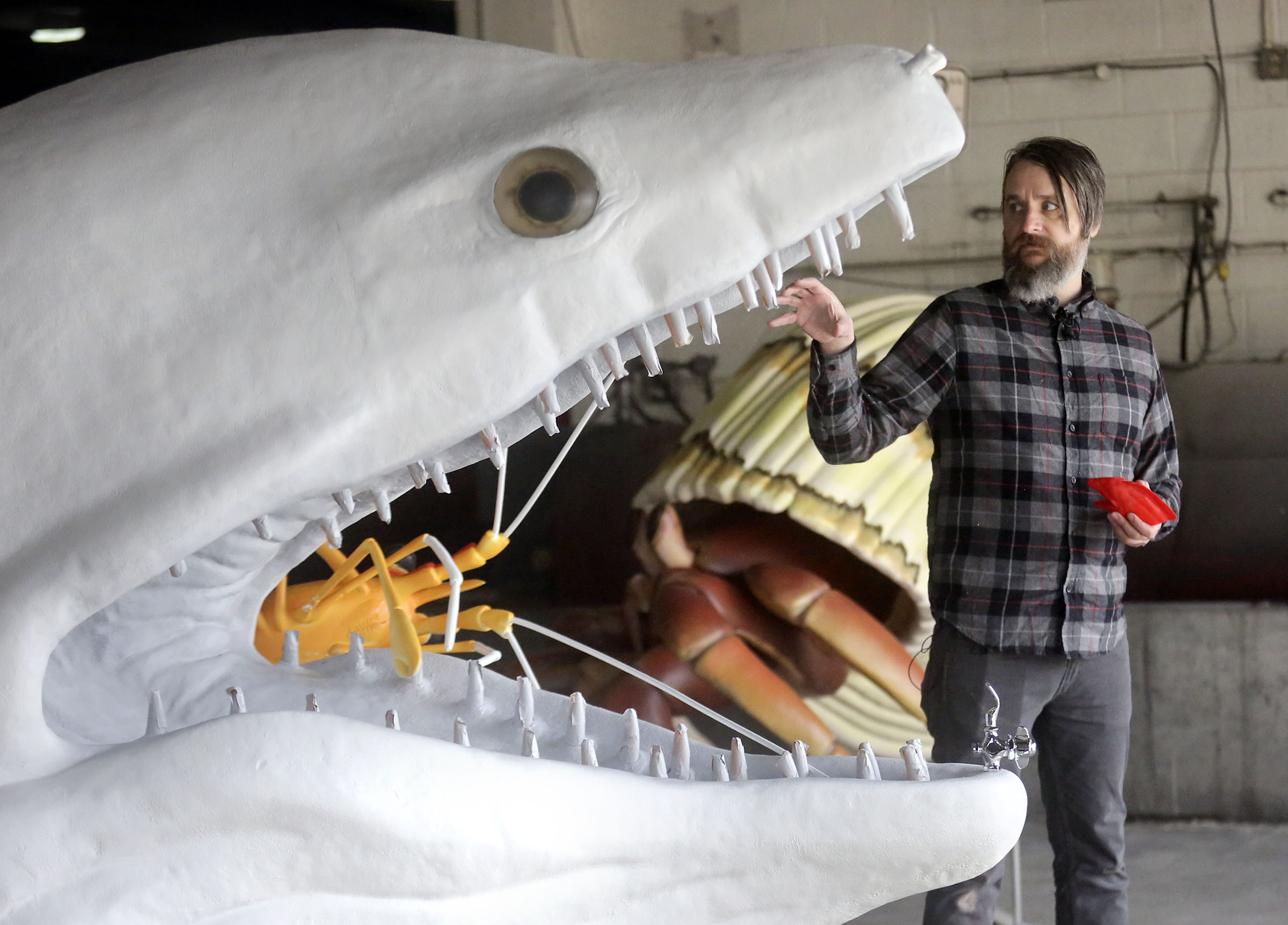 Wildlife sculptor Stephen Kesler, owner of Tusk Sculptures, talks about a sculpture of a honeycomb moray eel at his workshop in Salt Lake City on Tuesday, Feb. 18, 2020. The sculpture, which will also serve as a water fountain, will be displayed at the Loveland Living Planet Aquarium when it is finished.