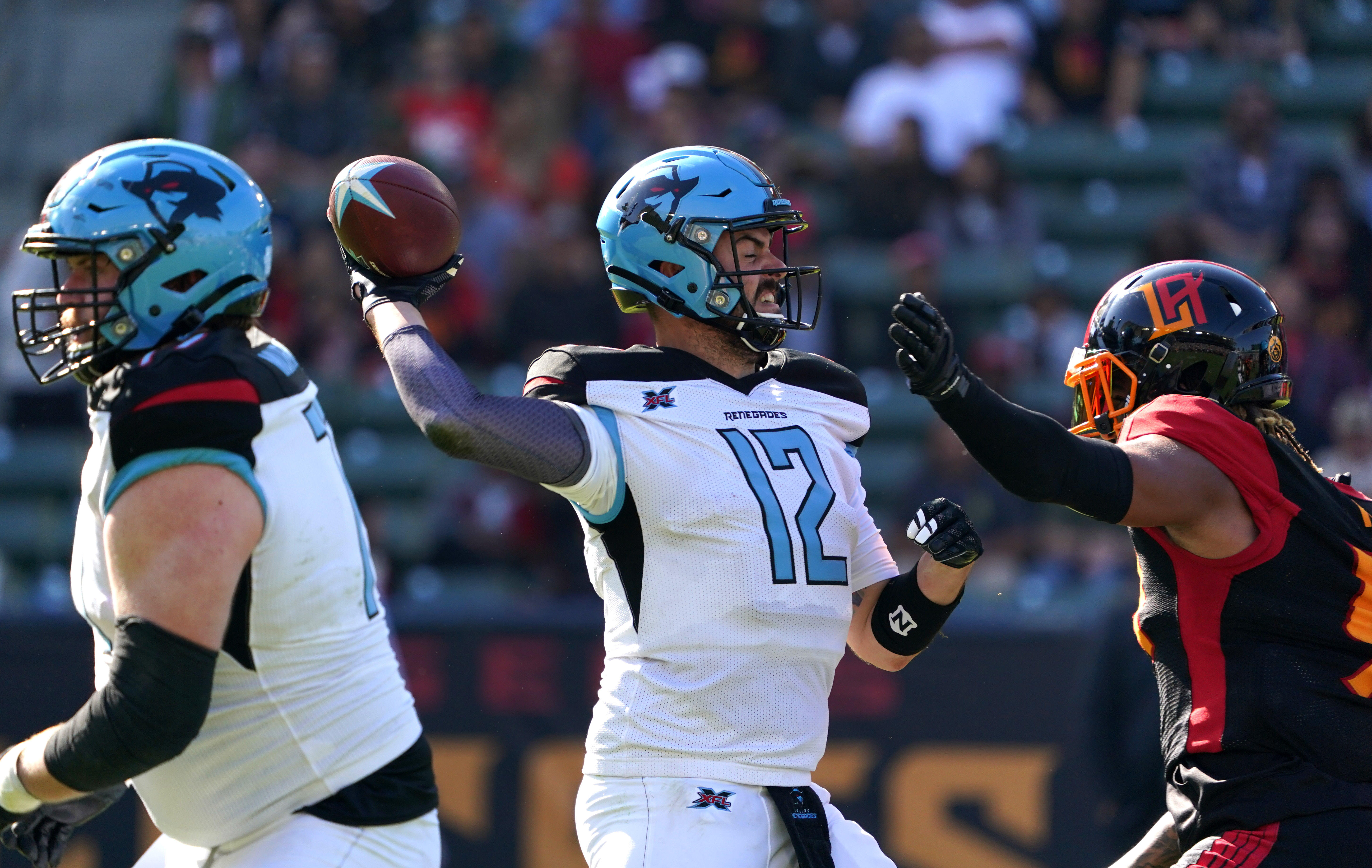 Dallas Renegades quarterback Landry Jones throws the ball under pressure from LA Wildcats linebacker Willie Mays in the fourth quarter at Dignity Health Sports Park.