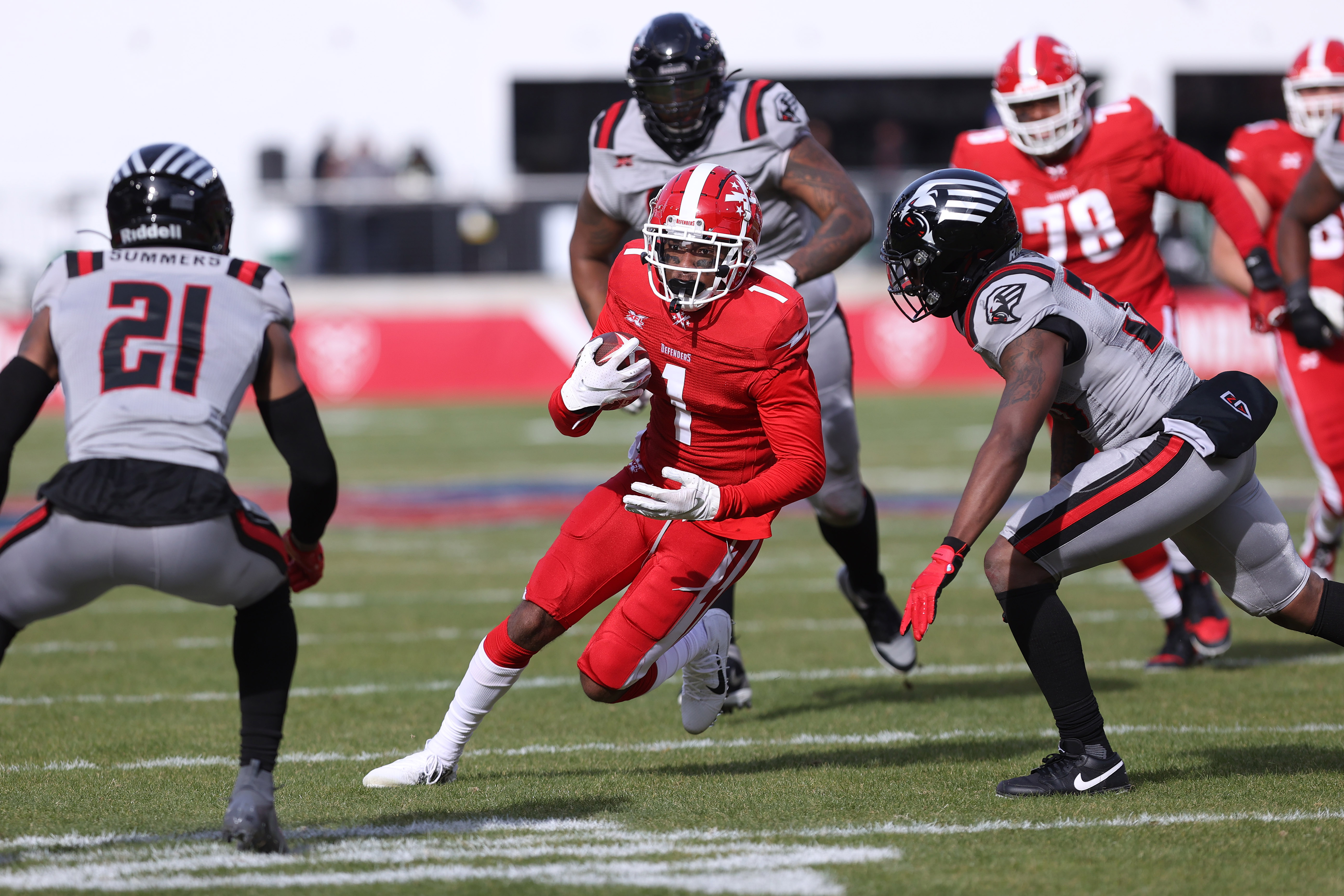 DC Defenders wide receiver DeAndre Thompkins runs with the pall as NY Guardians cornerback Jamar Summers and NY Guardians safety Andrew Soroh chase in the second quarter at Audi Field.