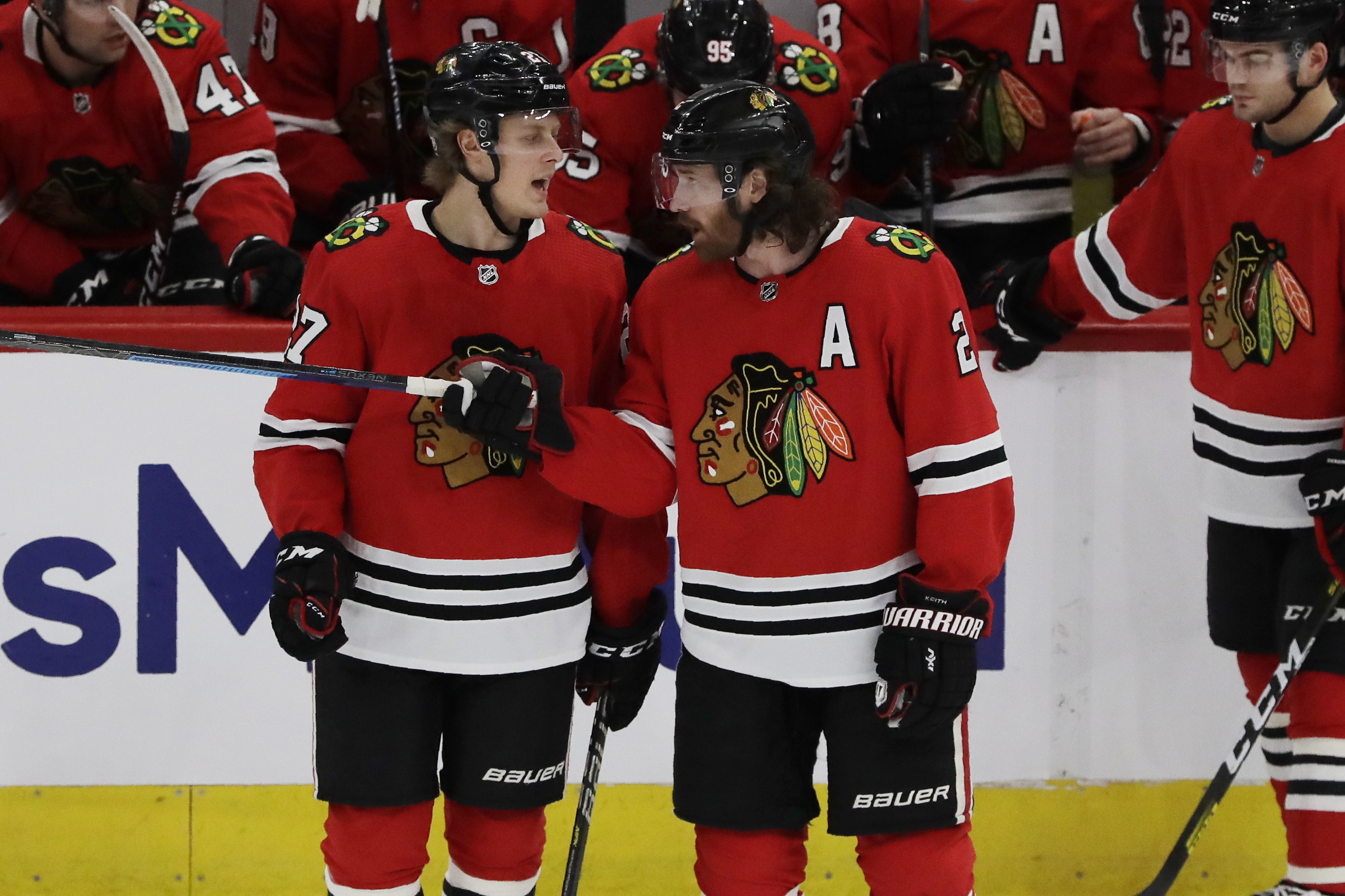 Duncan Keith (right) and Adam Boqvist have been mentor and mentee since autumn.