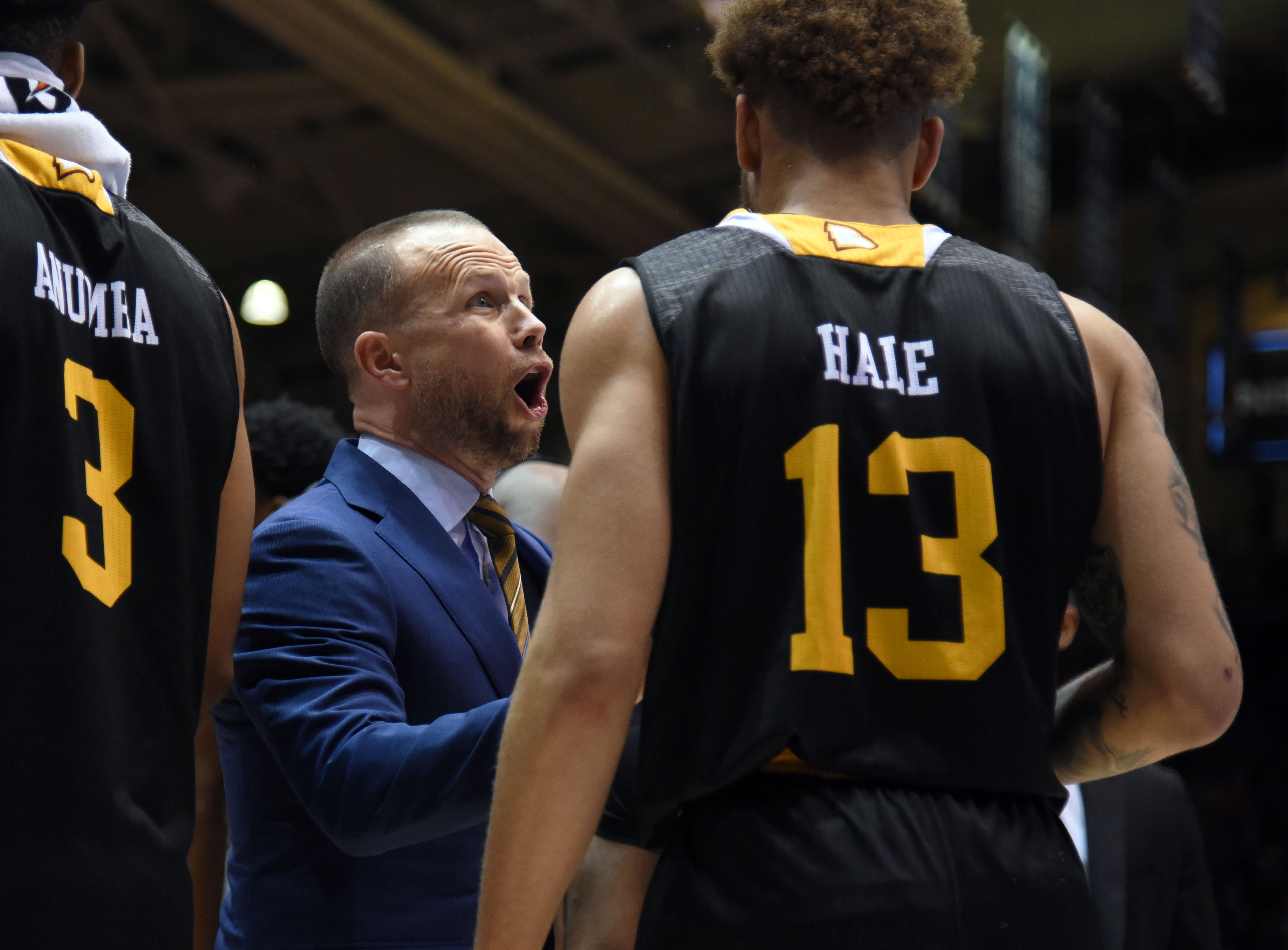 Winthrop Eagles head coach Pat Kelsey (left) talks to guard Hunter Hale during the first half against the Duke Blue Devils at Cameron Indoor Stadium.