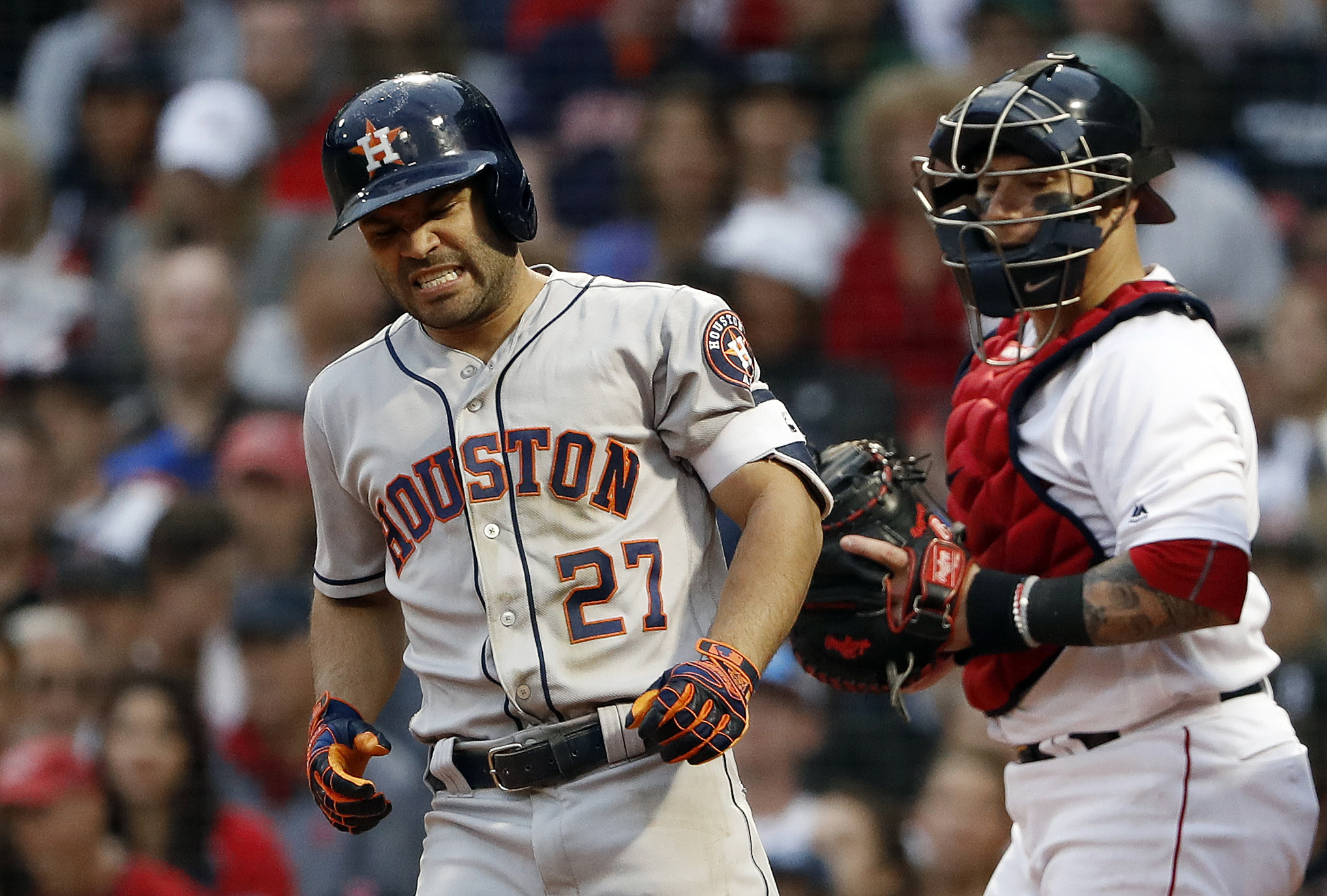 Houston Astros second baseman Jose Altuve grimaces after being hit by a pitch during the sixth inning as Boston Red Sox catcher Christian Vazquez looks on at Fenway Park.