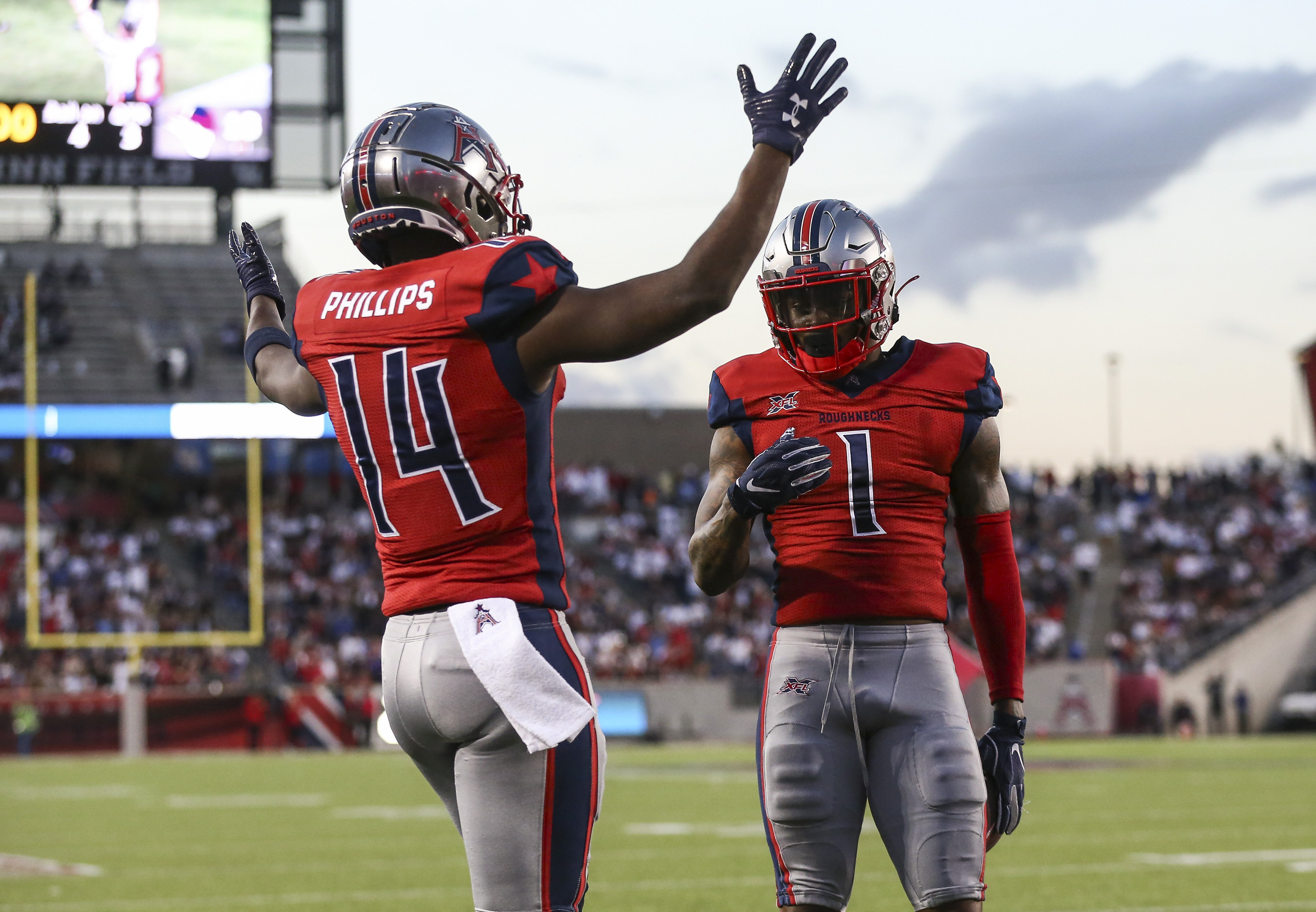 Houston Roughnecks wide receiver Cam Phillips and wide receiver Kahlil Lewis celebrate after scoring a touchdown during the third quarter against the Los Angeles Wildcats in a XFL football game at TDECU Stadium.