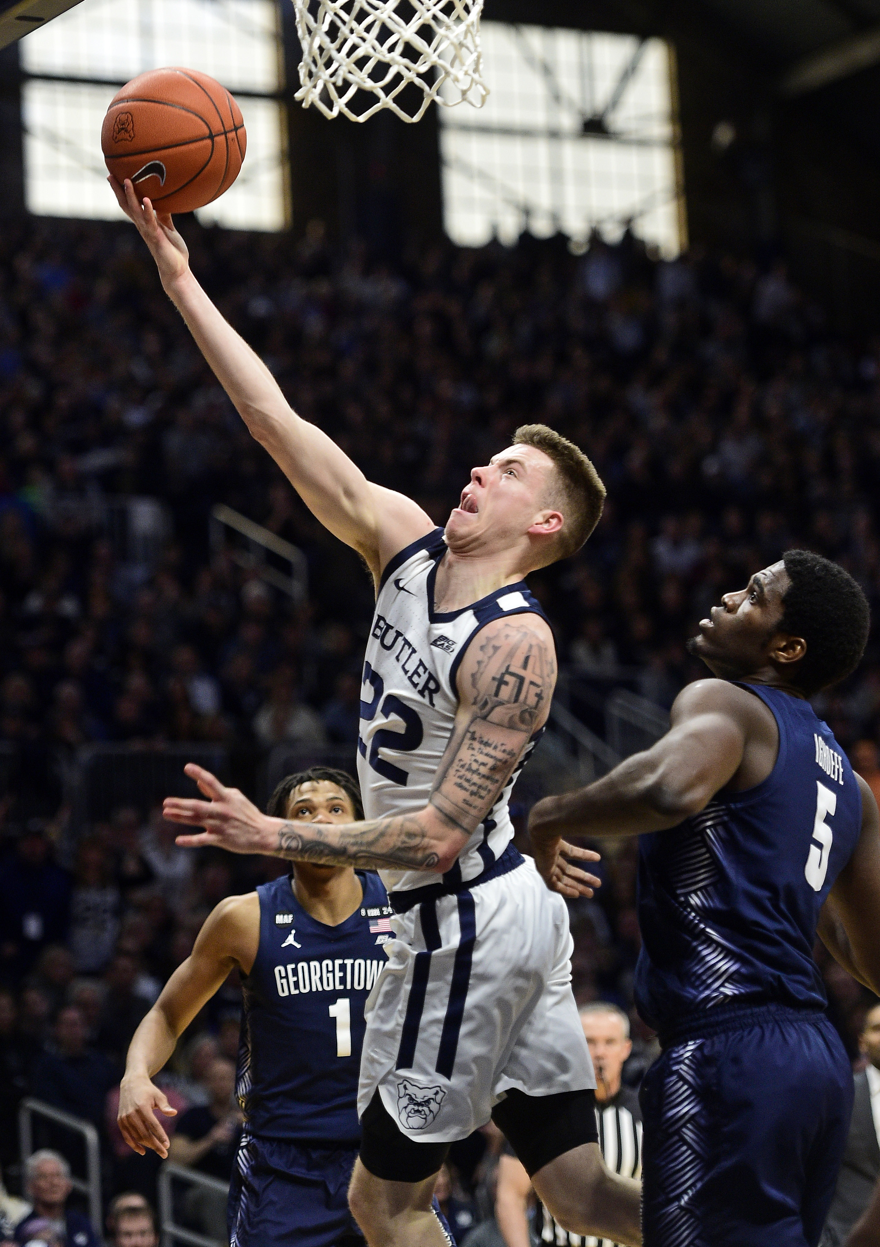 Butler Bulldogs forward Sean McDermott shoots the ball past past Georgetown Hoyas center Timothy Ighoefe at Hinkle Fieldhouse.