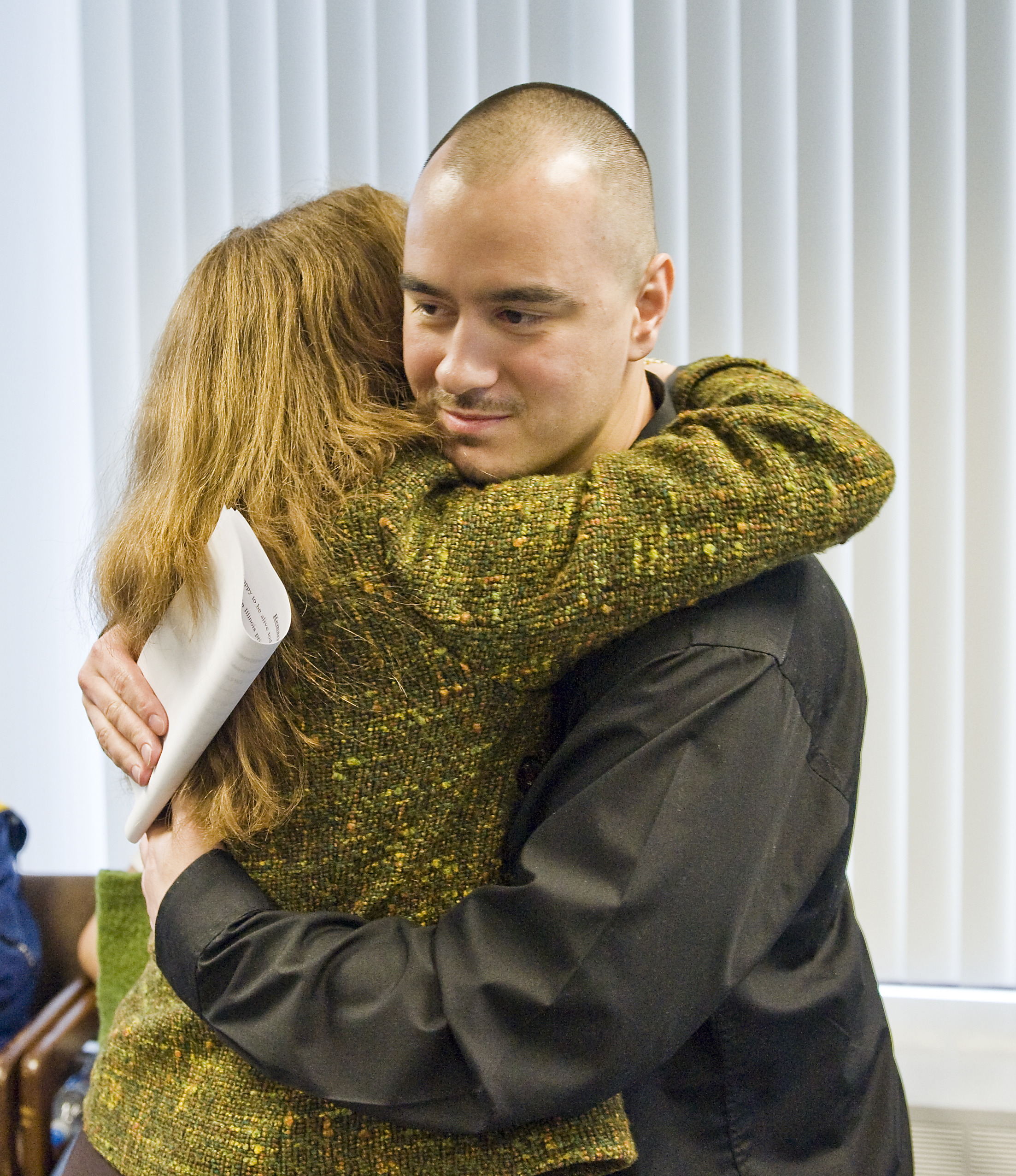 """Thaddeus """"T.J."""" Jimenez celebrates his freedom in 2009 after winning release for a killing he said he didn't commit."""