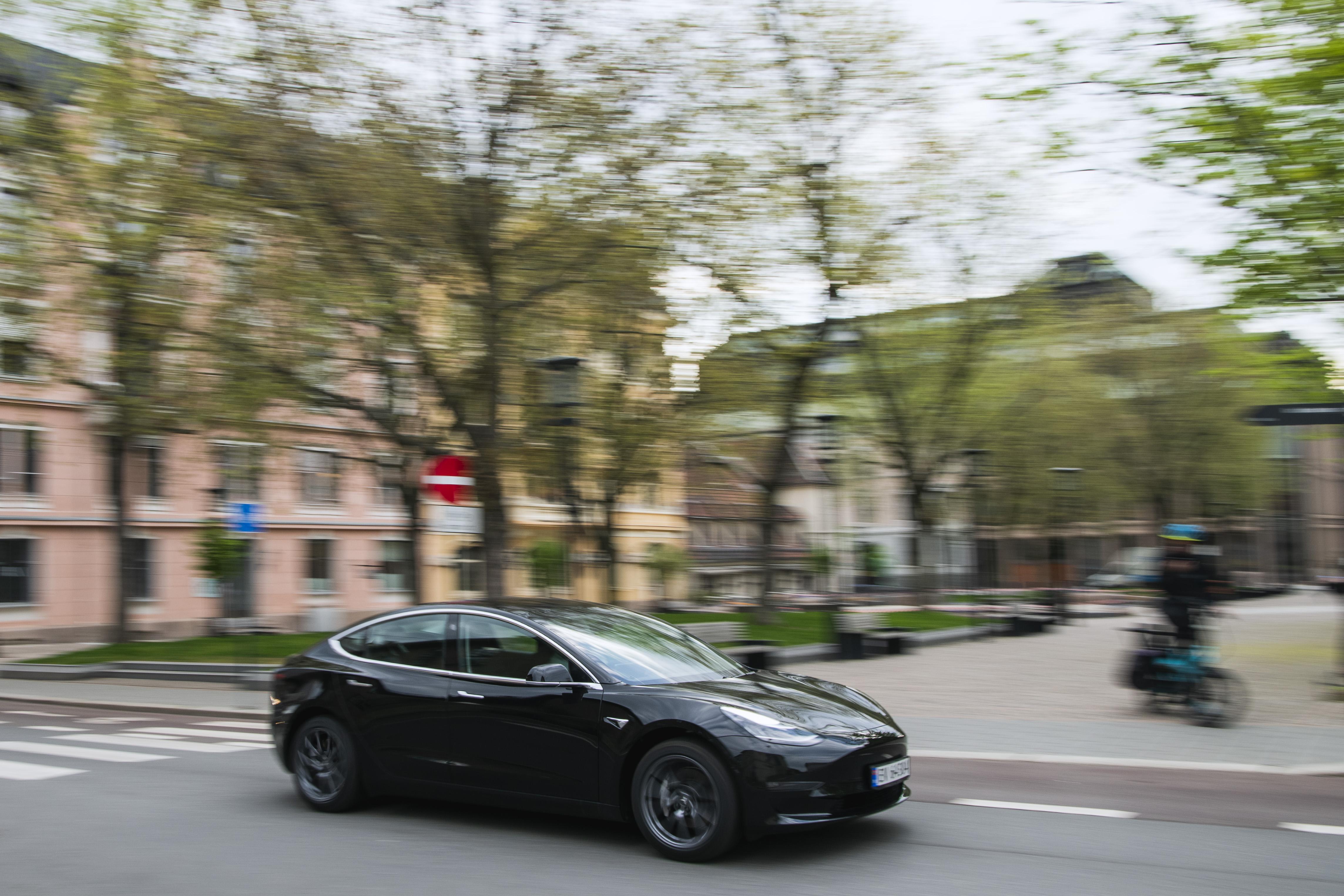 A Tesla automobile speeding down a street.