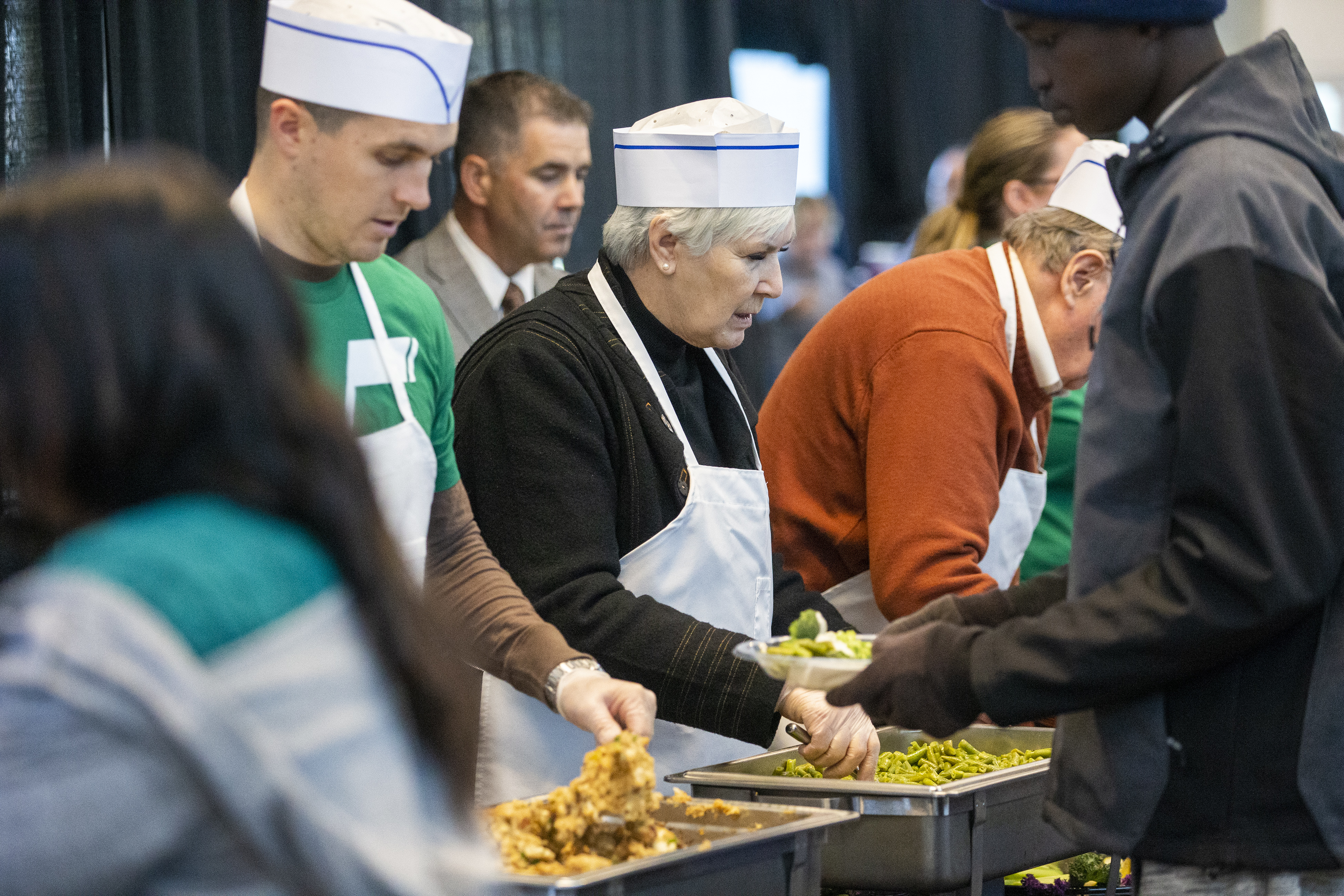 Jazz owner Gail Miller dishes up food during the 20th annual We Care — We Share Thanksgiving Meal for local homeless and low-income individuals at the Vivint Smart Home Arena in Salt Lake City on Monday, Nov. 19, 2018. Miller is one of six car dealers from around the world to be honored for exceptional community service as part of Ford Motor Co.'s Salute to Dealers awards.