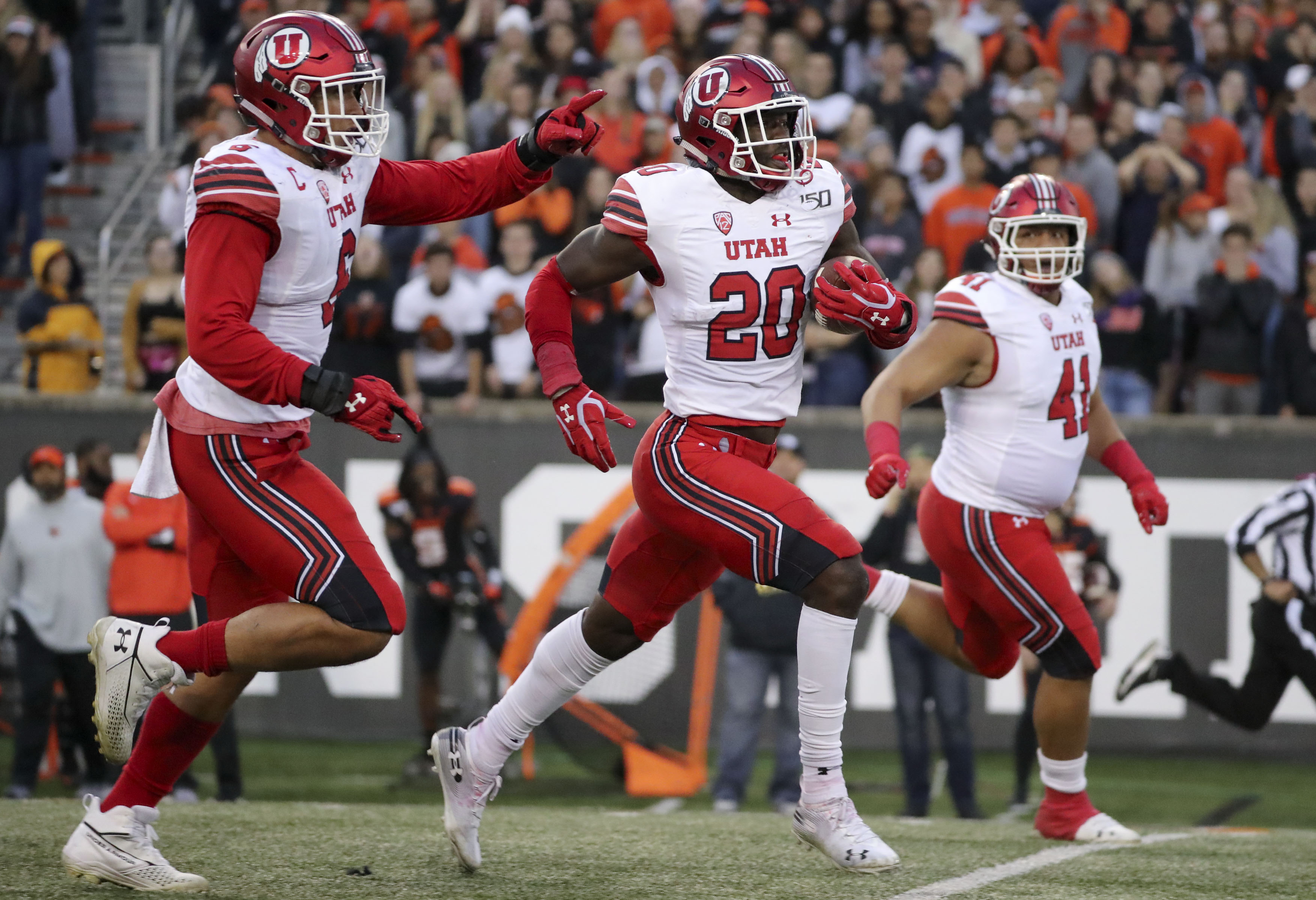 Utah Utes linebacker Devin Lloyd (20) runs for a touchdown after intercepting a pass during a football game against the Oregon State Beavers at Reser Stadium in Corvallis, Ore., on Saturday, Oct. 12, 2019. Utah won 52-7.