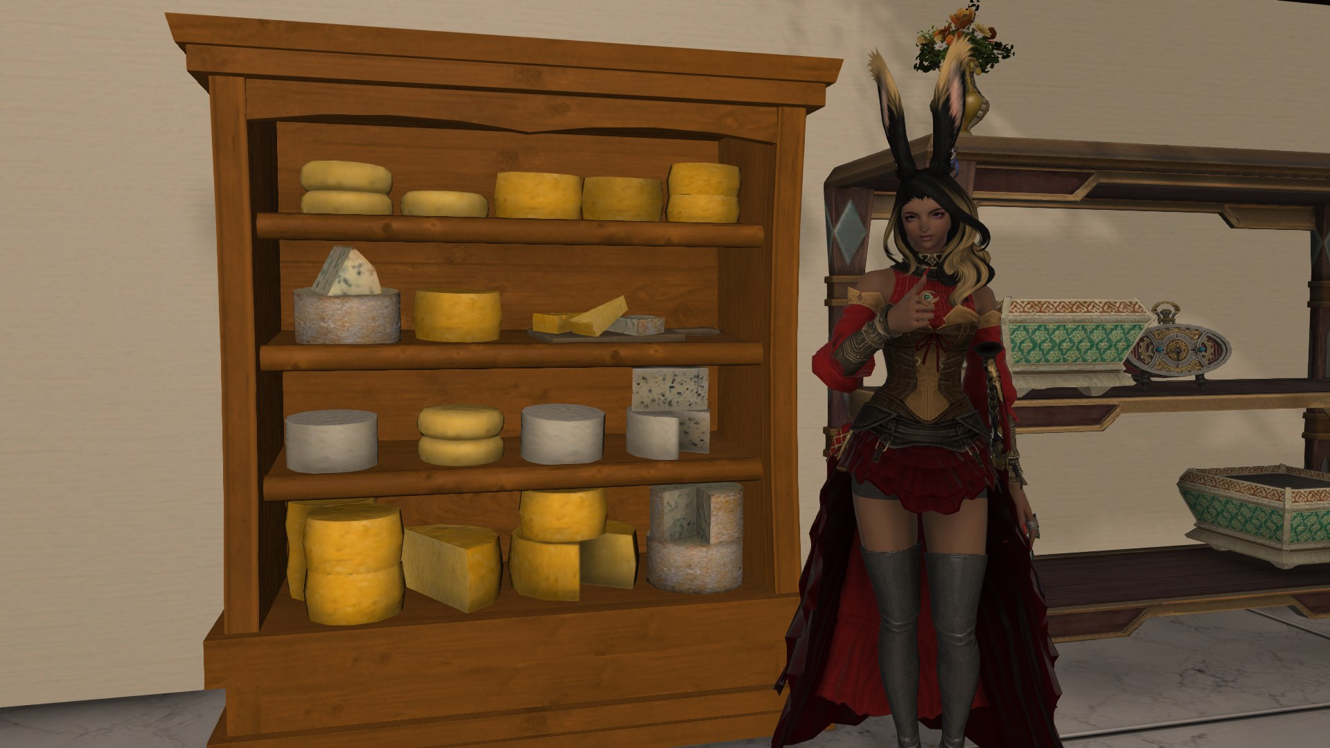 A woman with rabbit ears stands next to a shelf filled with cheese, giving a thumbs up.