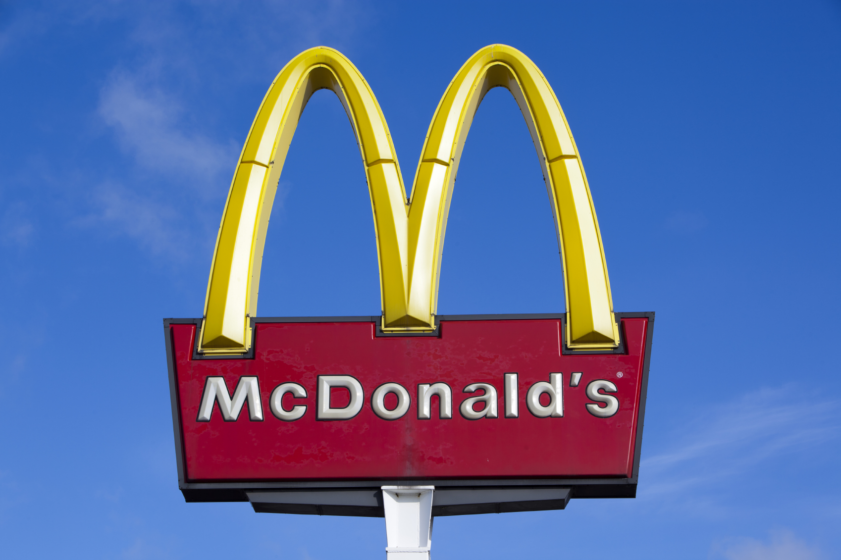 McDonald's logo against blue sky.