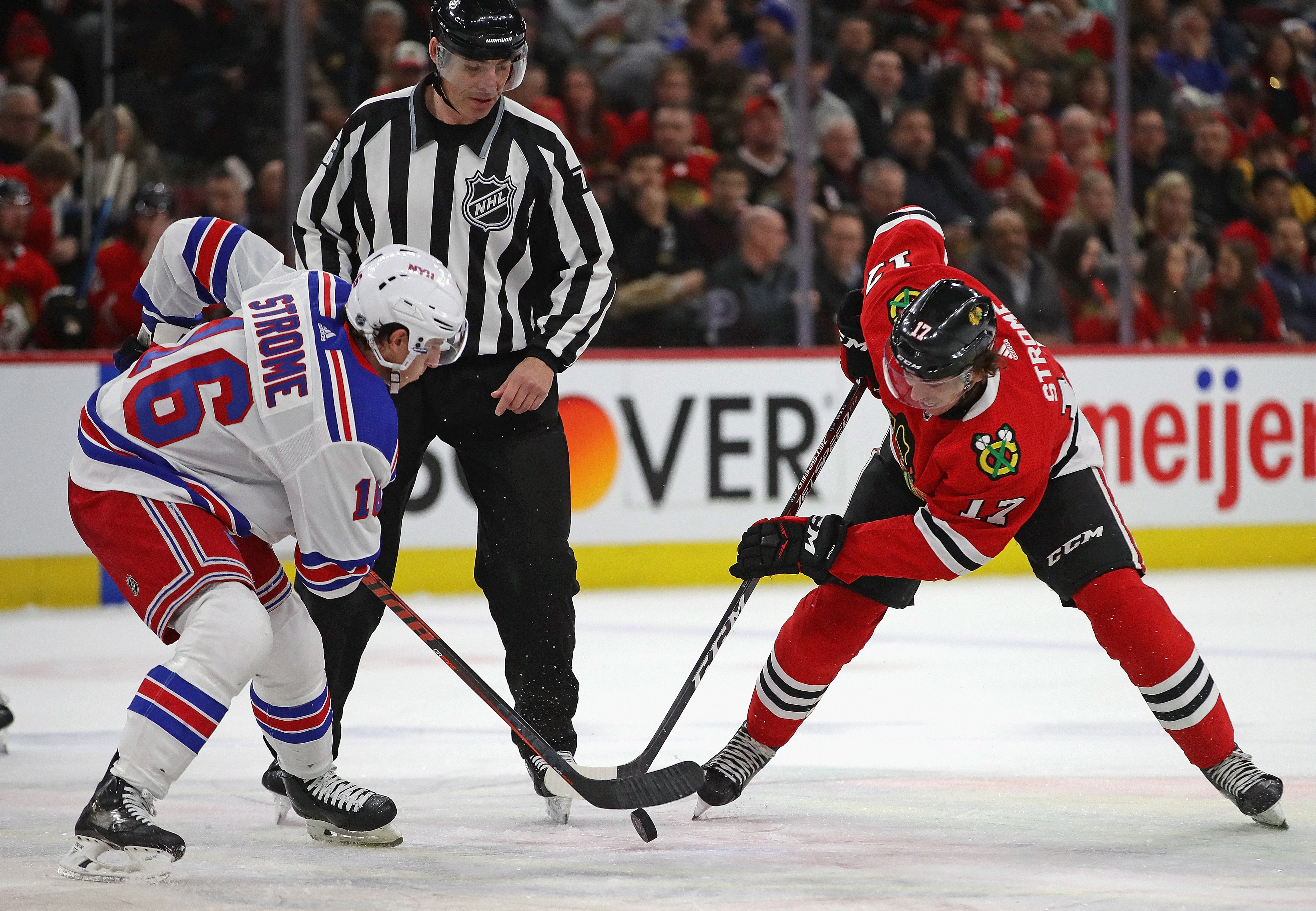 Brothers Ryan Strome (left, Rangers) and Dylan Strome (right, Blackhawks) fittingly squared off in the opening faceoff Wednesday.