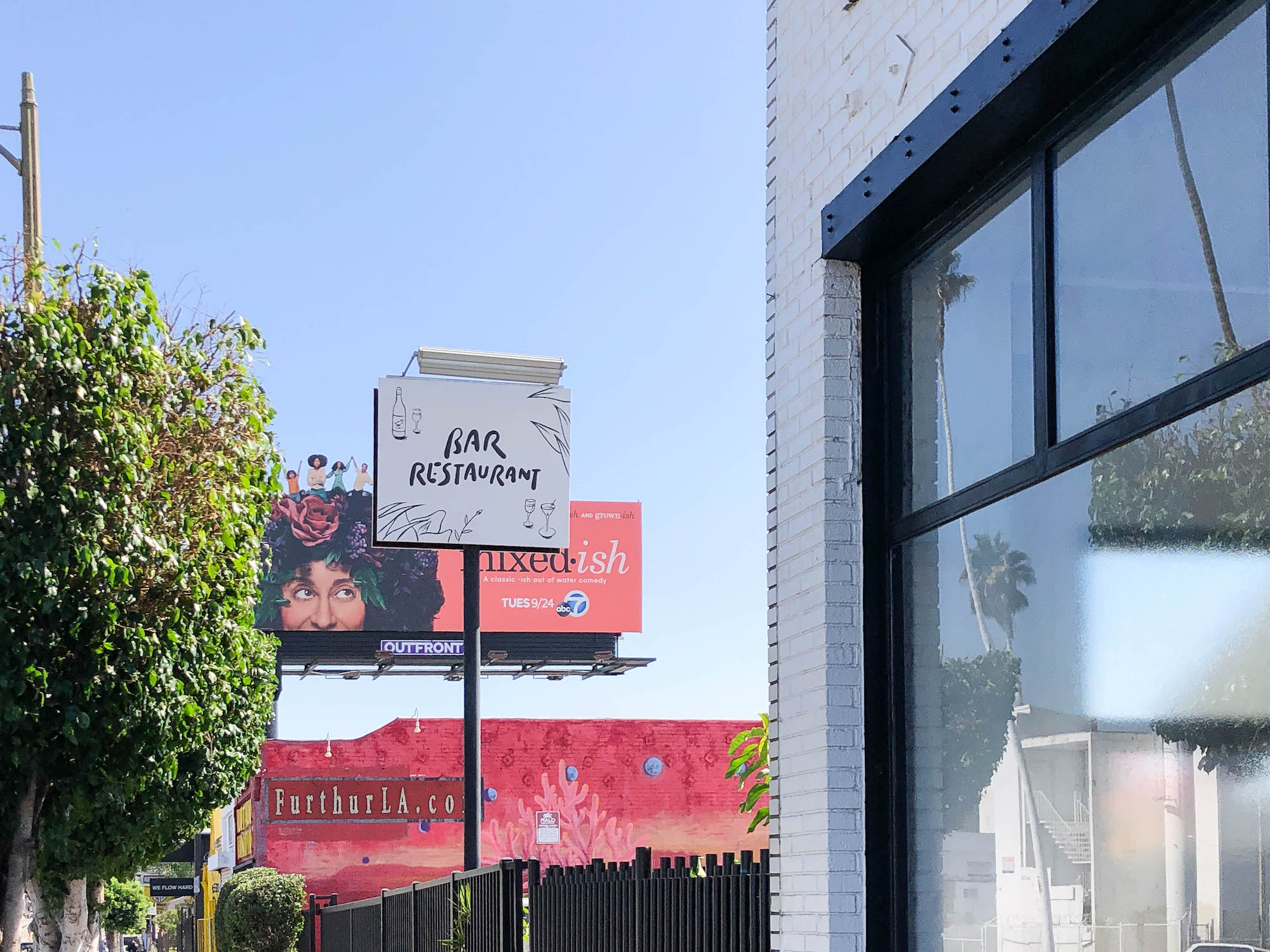 Signage for a place called Bar Restaurant on a sunny day in Los Angeles.