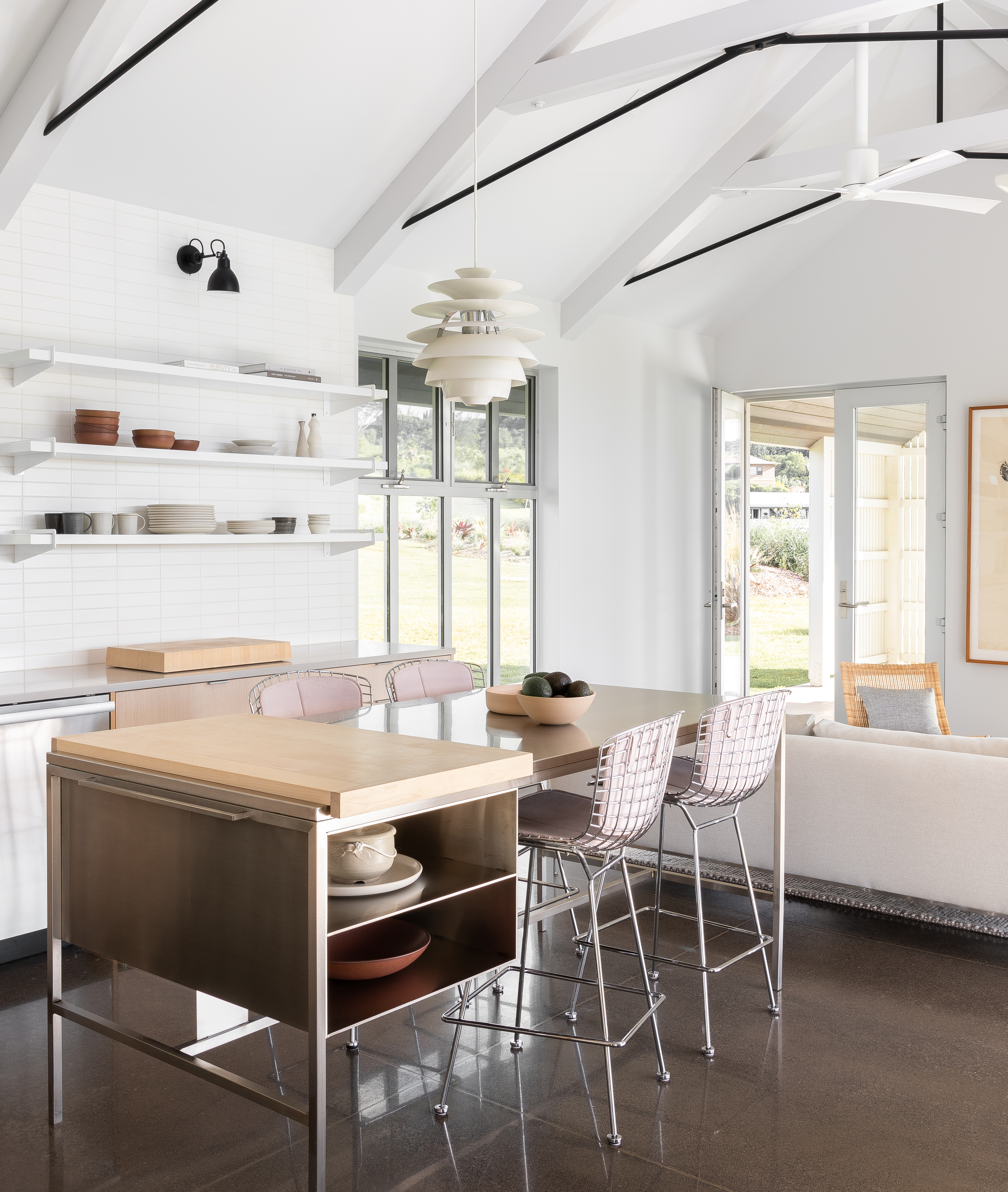 Kitchen lighting with a diffuse overhead and focussed wall sconces for task lighting.