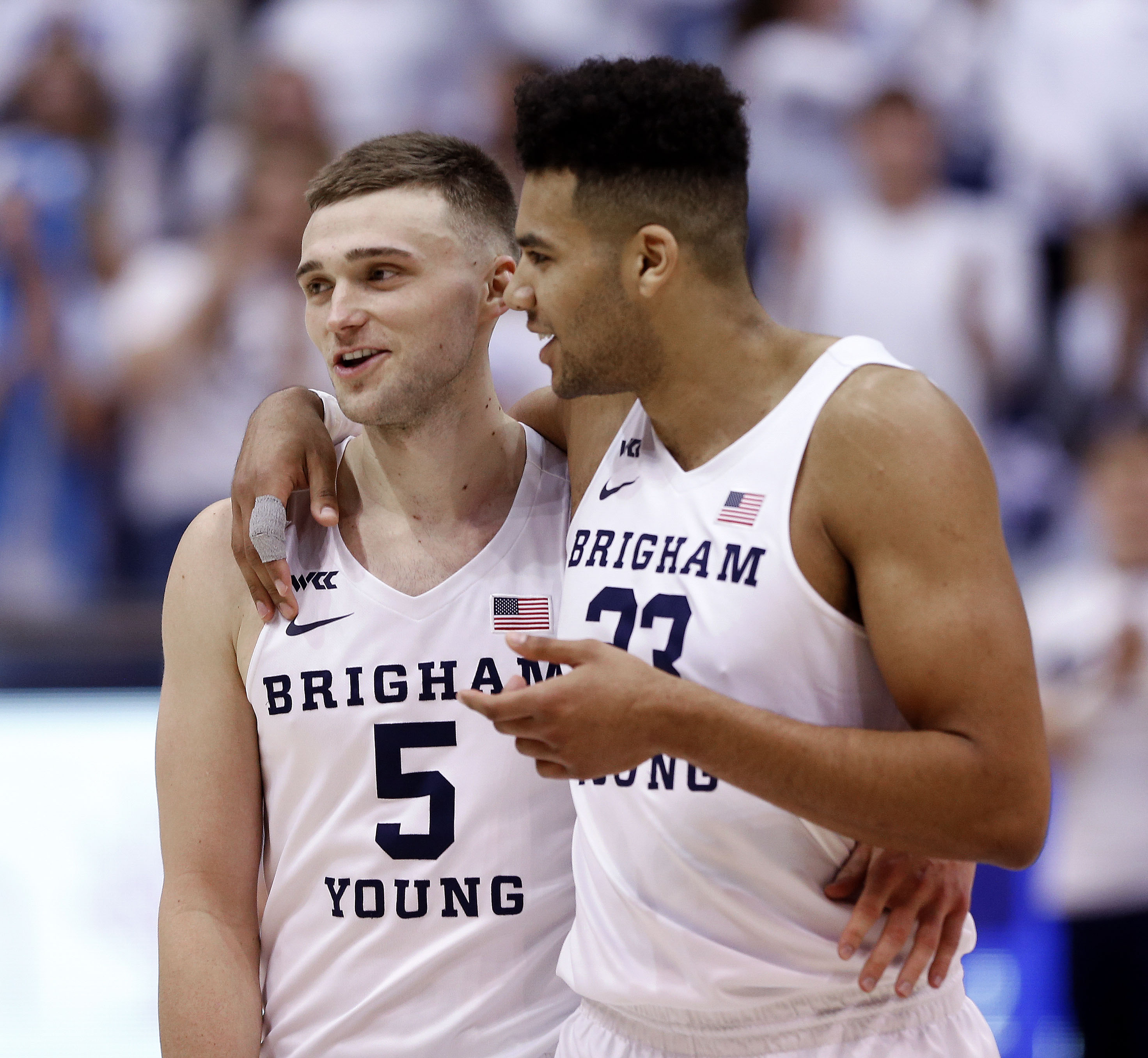 Brigham Young Cougars guard Jake Toolson (5) and forward Yoeli Childs (23) walk off the court after beating Santa Clara at Brigham Young University in Provo on Thursday, Feb. 20, 2020.