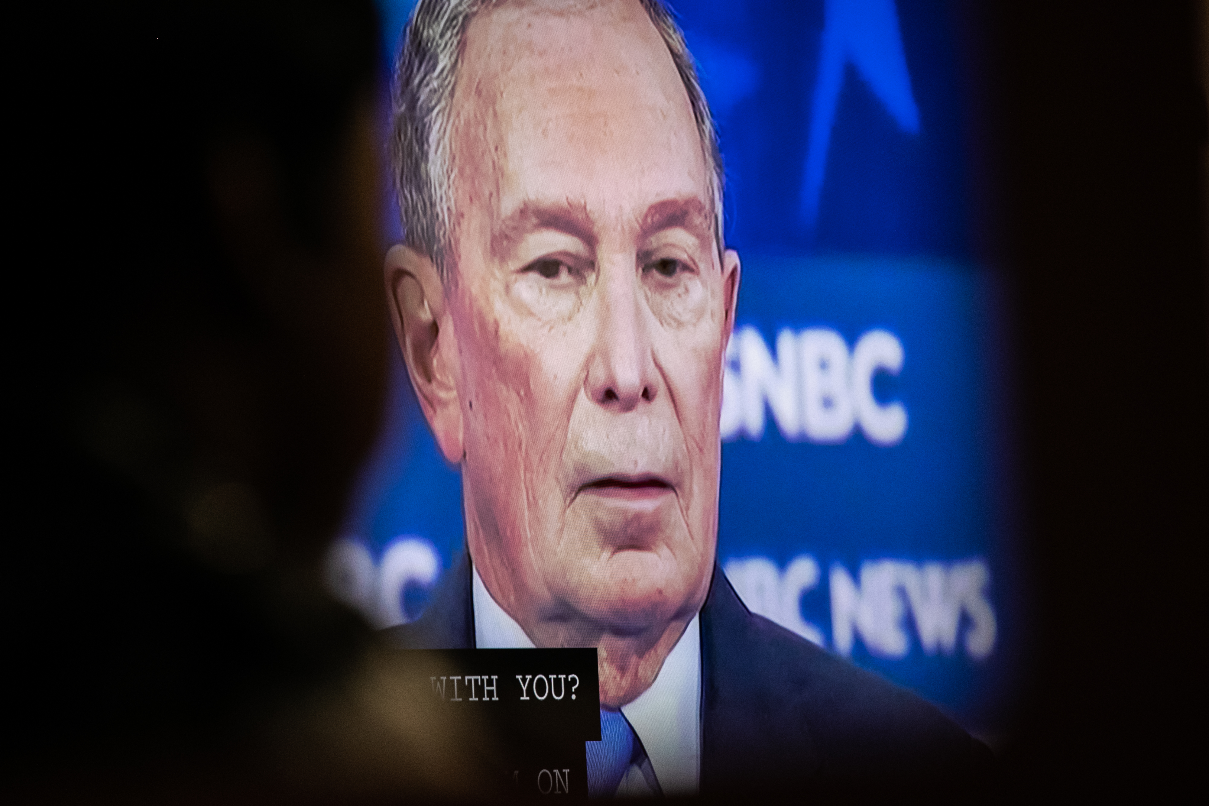 Democratic presidential candidate former New York City Mayor Mike Bloomberg is shown on a screen during a debate watch party at the candidate's field office on Wednesday in the Brooklyn borough of New York City