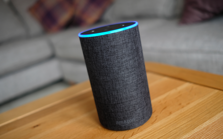 An Amazon Echo smart speaker on a table.