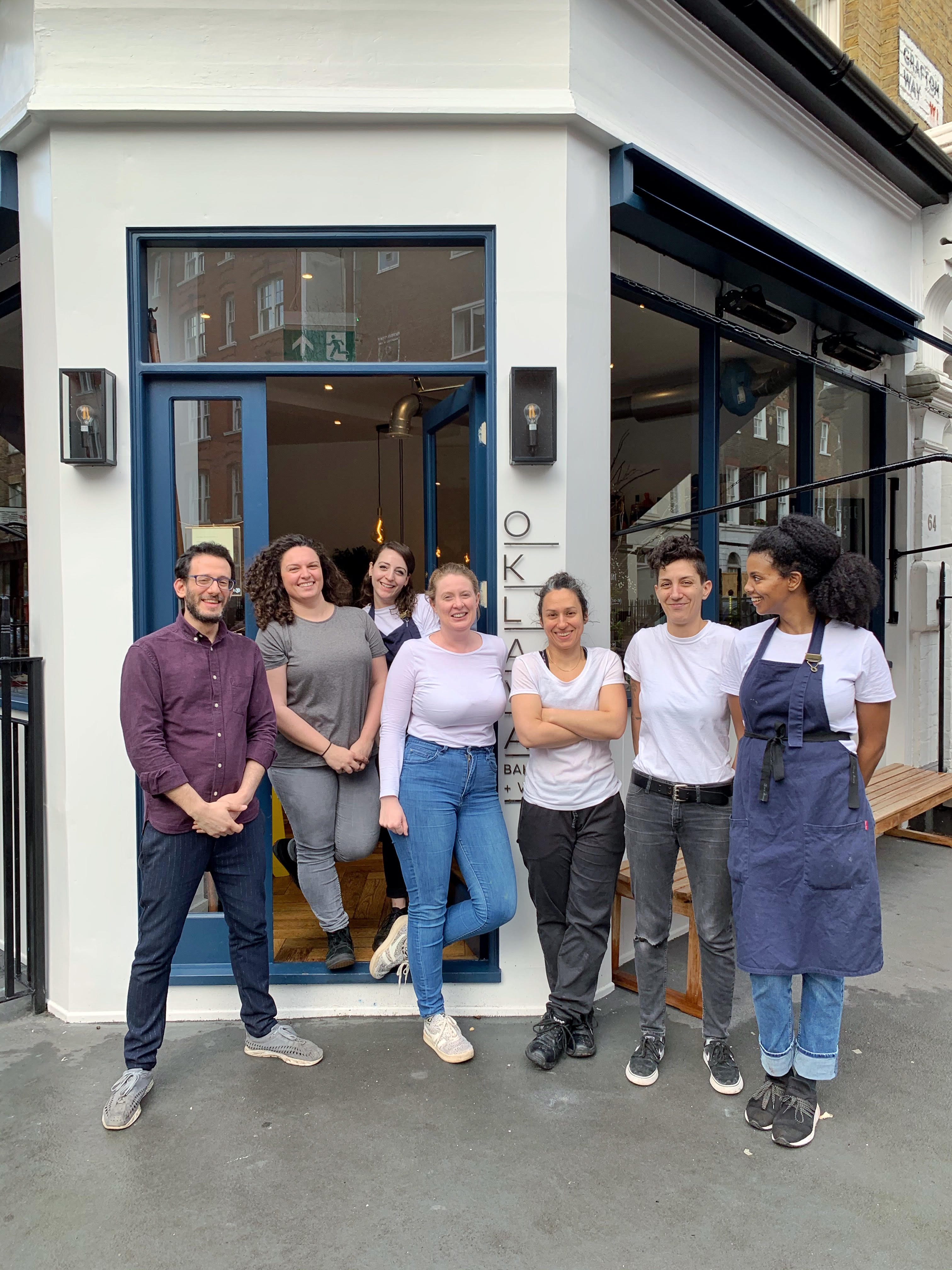 The Oklava team outside its recently opened Fitzrovia bakery and wine bar has challenged Home Secretary Priti Patel over the government's recently announced immigration system overhaul
