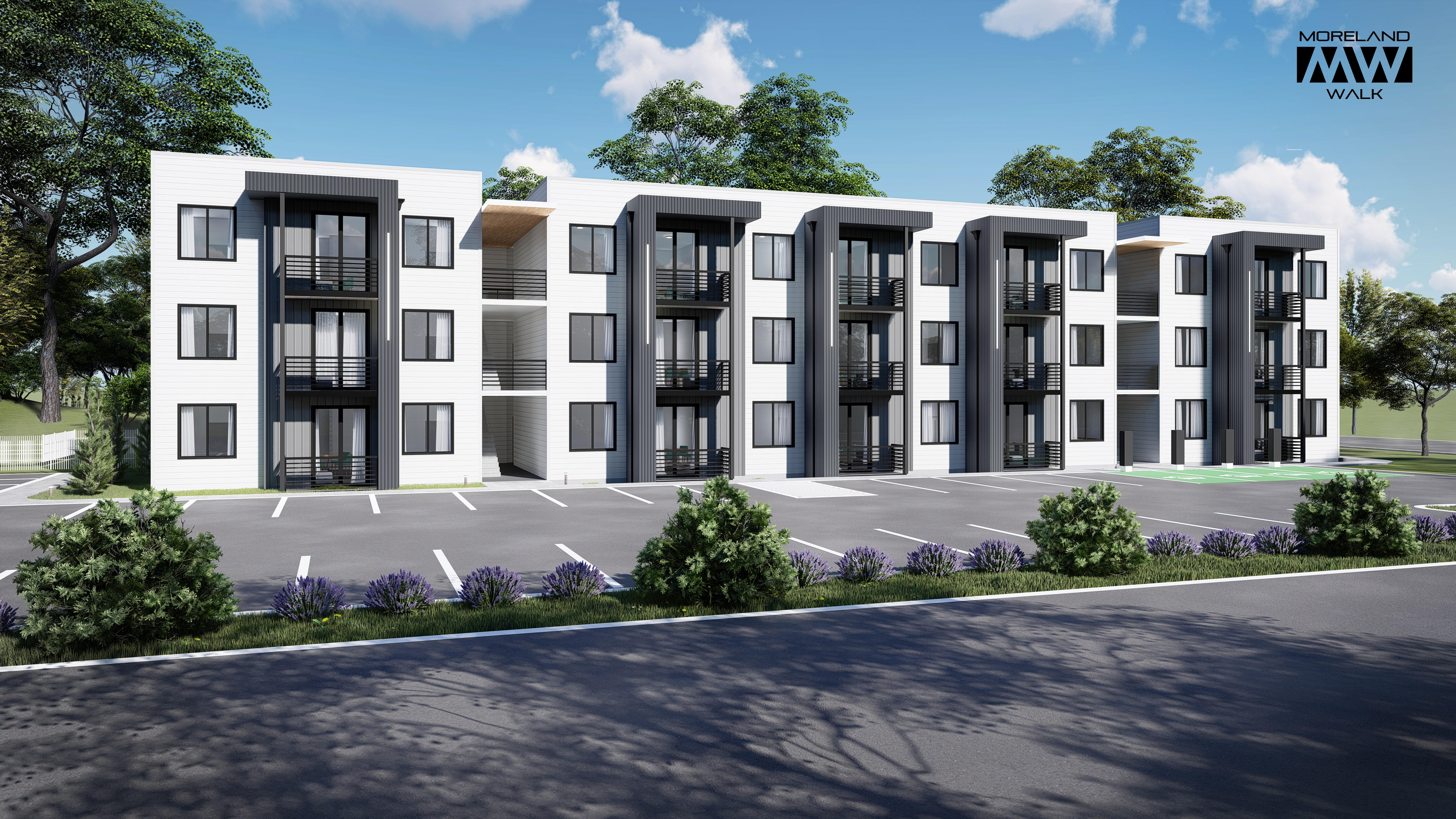 A three-story complex of condos next to a parking lot under a blue sky in renderings.
