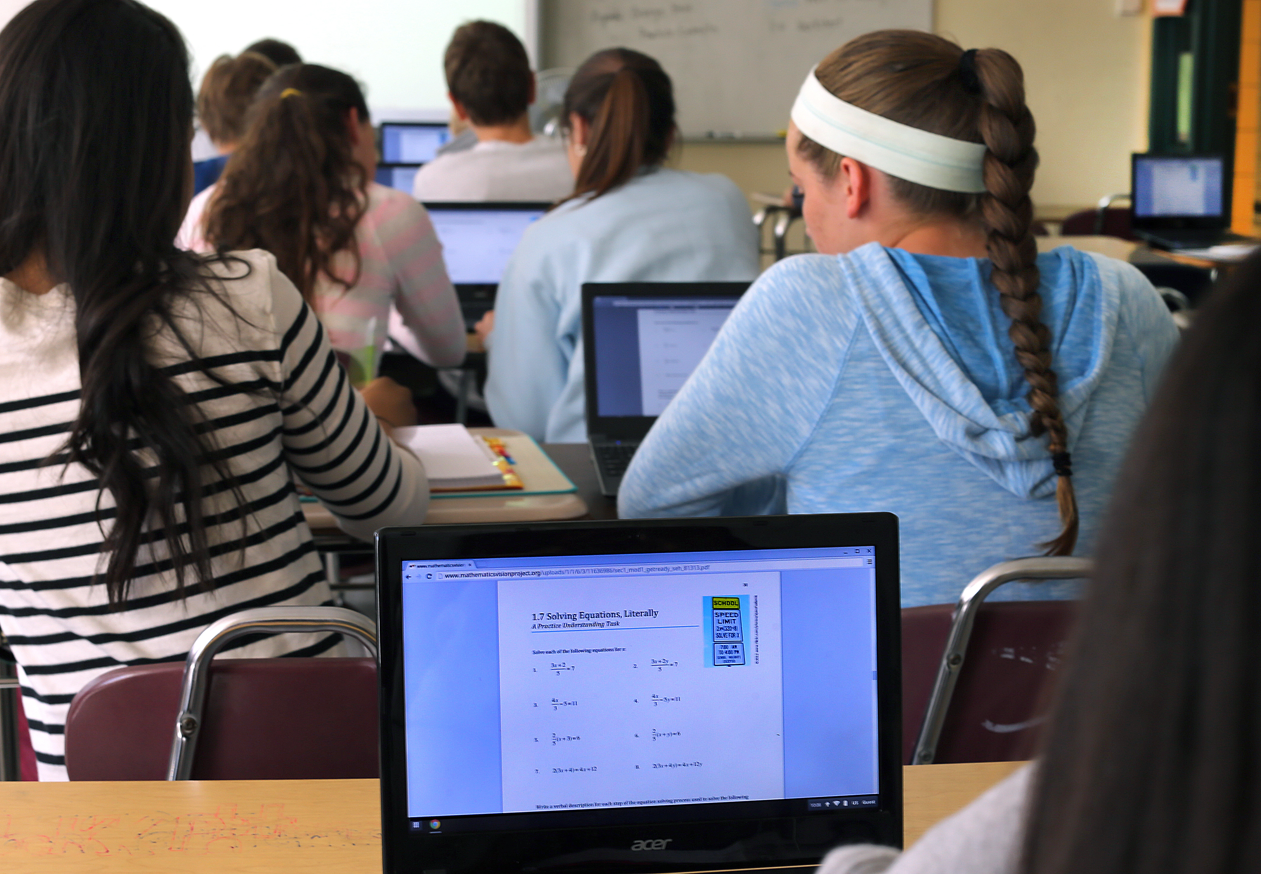 Students use Chromebooks in a classroom.