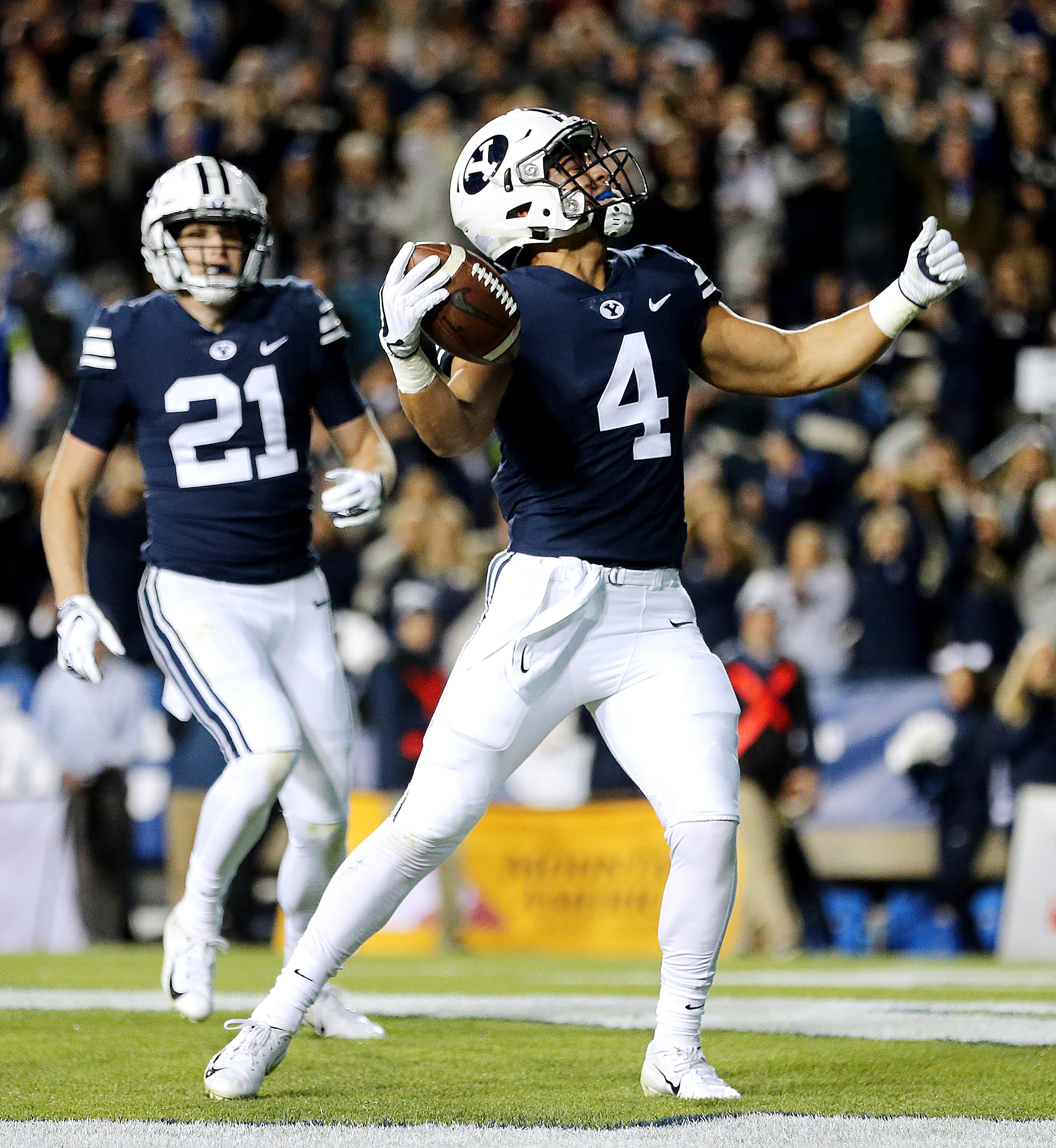 BYU Cougars running back Lopini Katoa (4) celebrates a touchdown as BYU and Hawaii play at LaVell Edwards Stadium in Provo on Saturday, Oct. 13, 2018. Katoa was BYU's second-leading rusher in 2019, and will be counted on in 2020 to lead an inexperienced running backs group.