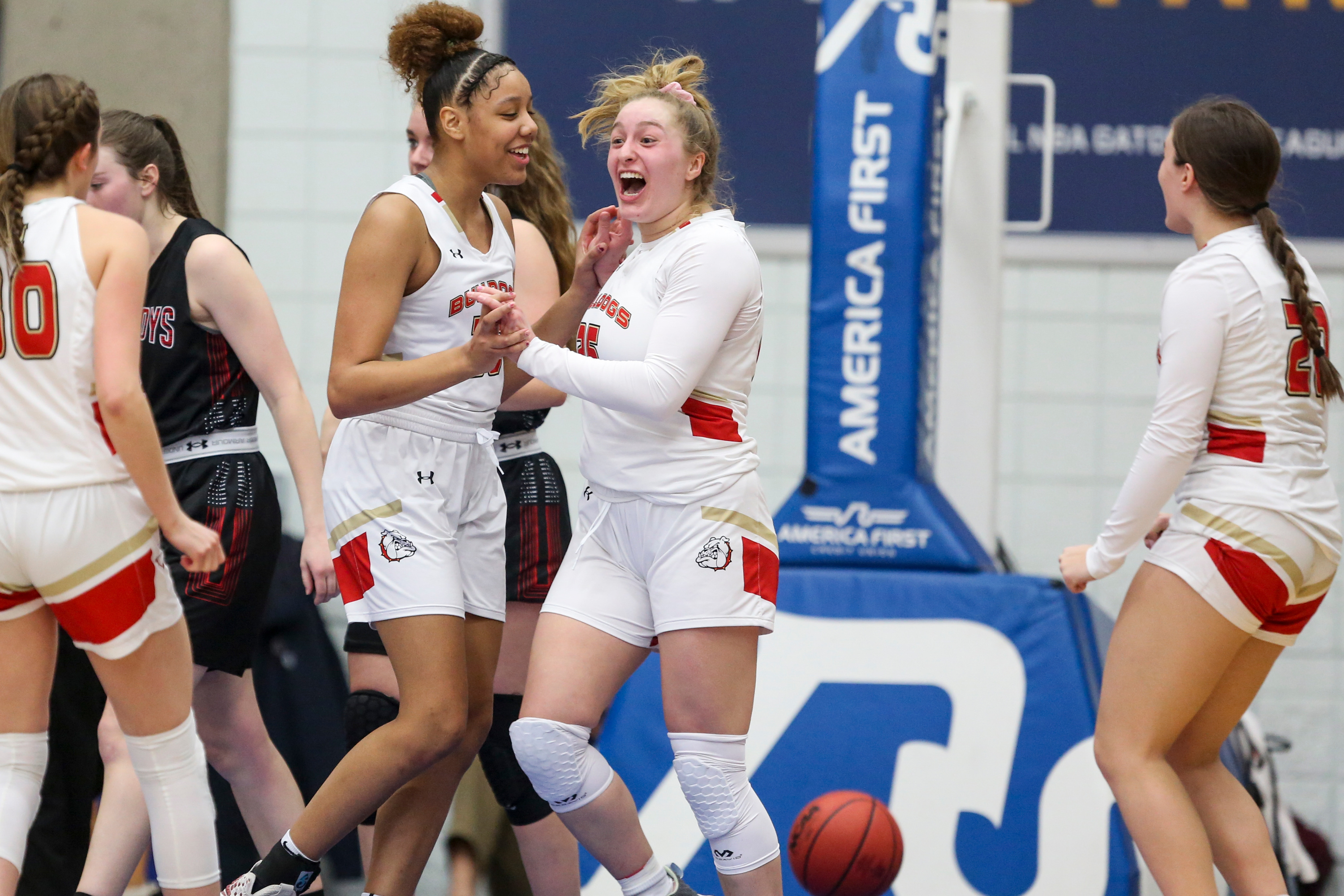 The Judge Memorial Bulldogs celebrate during the 3A girls basketball semifinals at the Lifetime Activities Center in Taylorsville on Friday, Feb. 21, 2020.