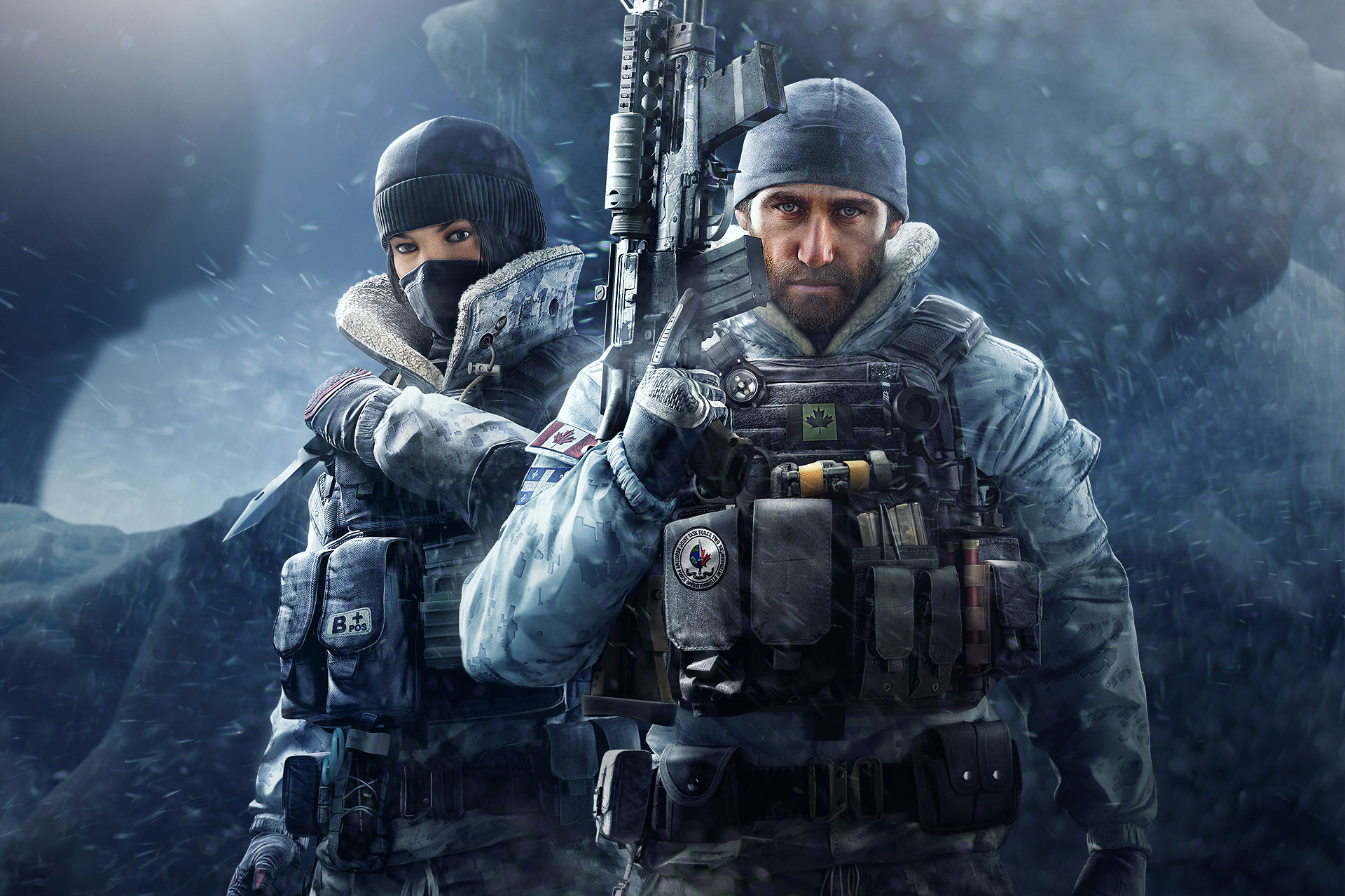 Promotional shot of Operators Frost (in a balaclava) and Buck (bearded, in a beanie, with a big rifle)