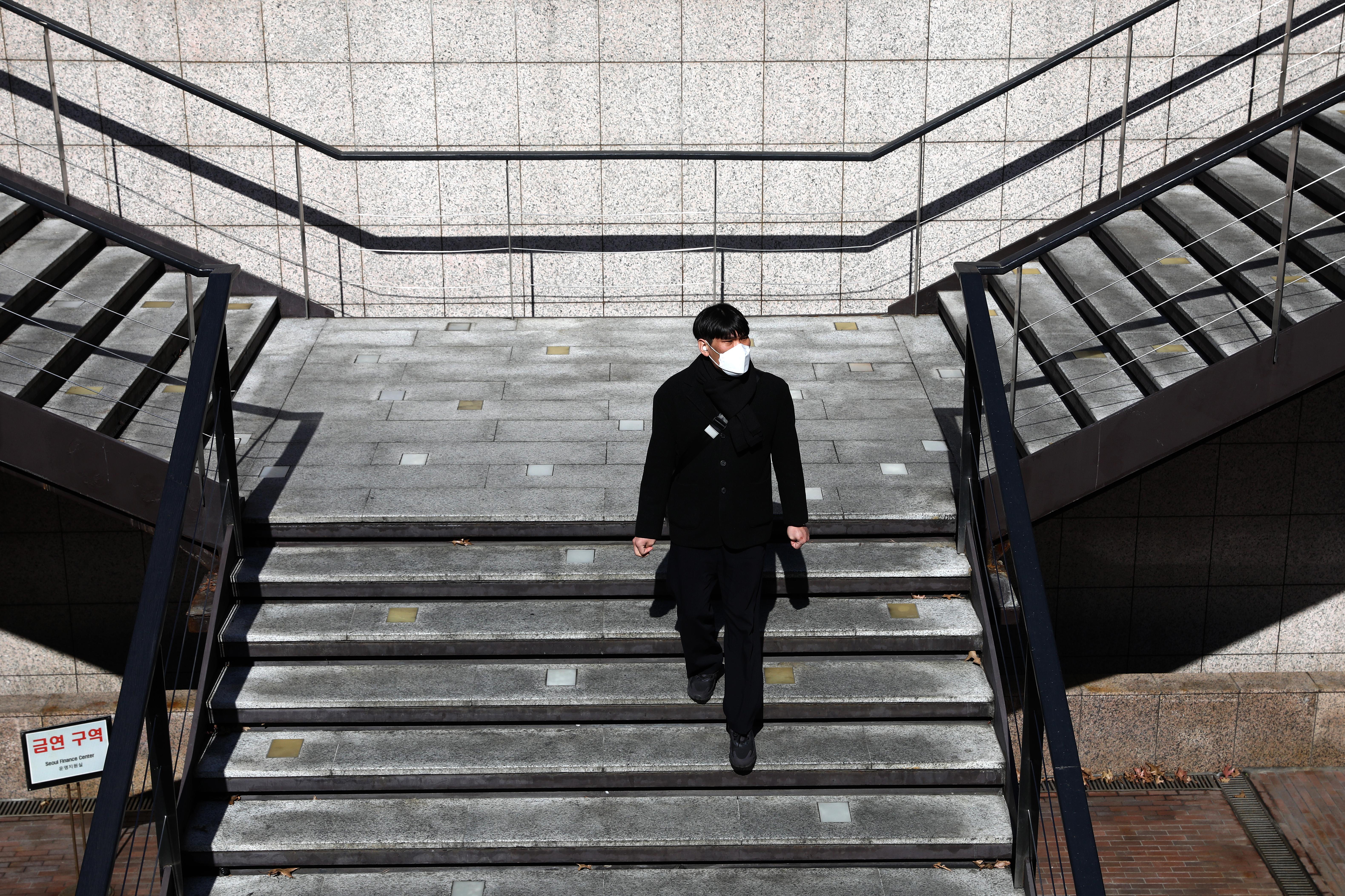 As Covid-19 cases rise, South Korea raises virus threat level to its maximum