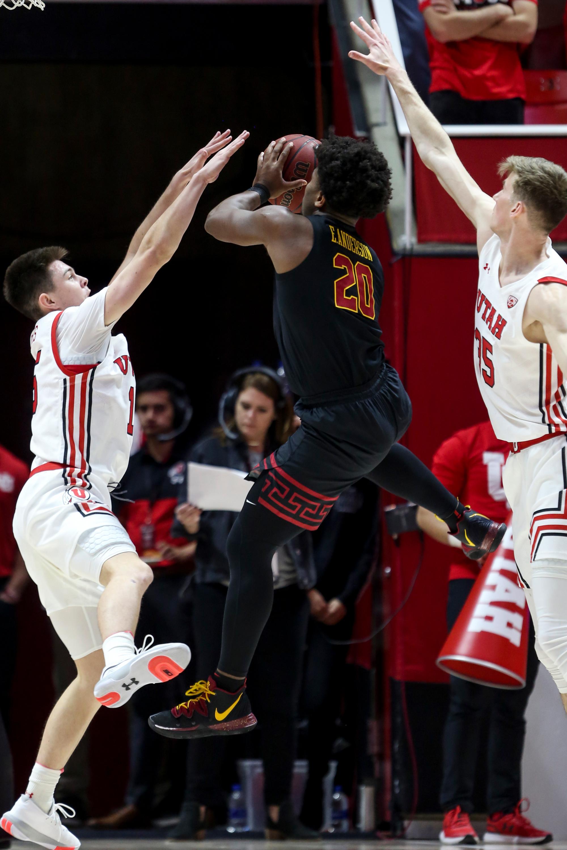 USC Trojans guard Jonah Mathews (2) goes for the basket while Utah Utes guard Rylan Jones (15) and center Branden Carlson (35) go up for a block at the Jon M. Huntsman Center in Salt Lake City on Sunday, Feb. 23, 2020.