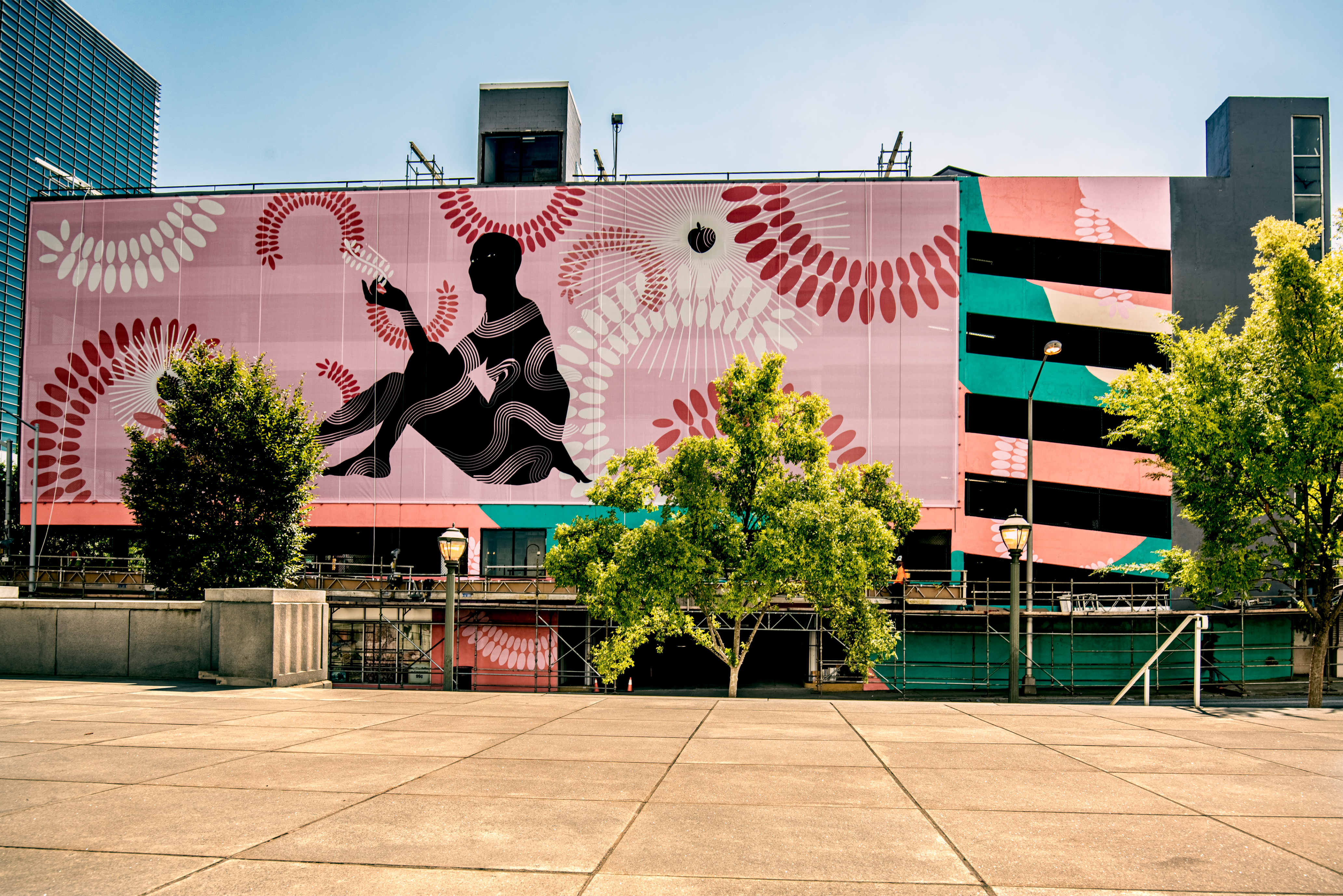 Mural of shadow figure with pink background.