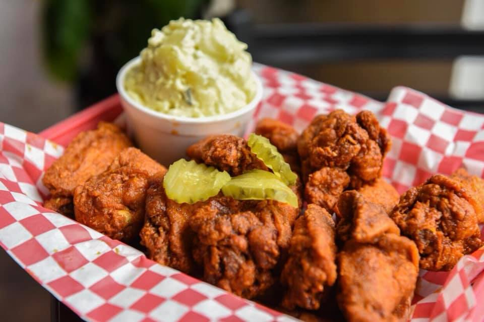 A red basket of hot chicken wings and drums from Helen's Hot Chicken on Edgewood in Atlanta
