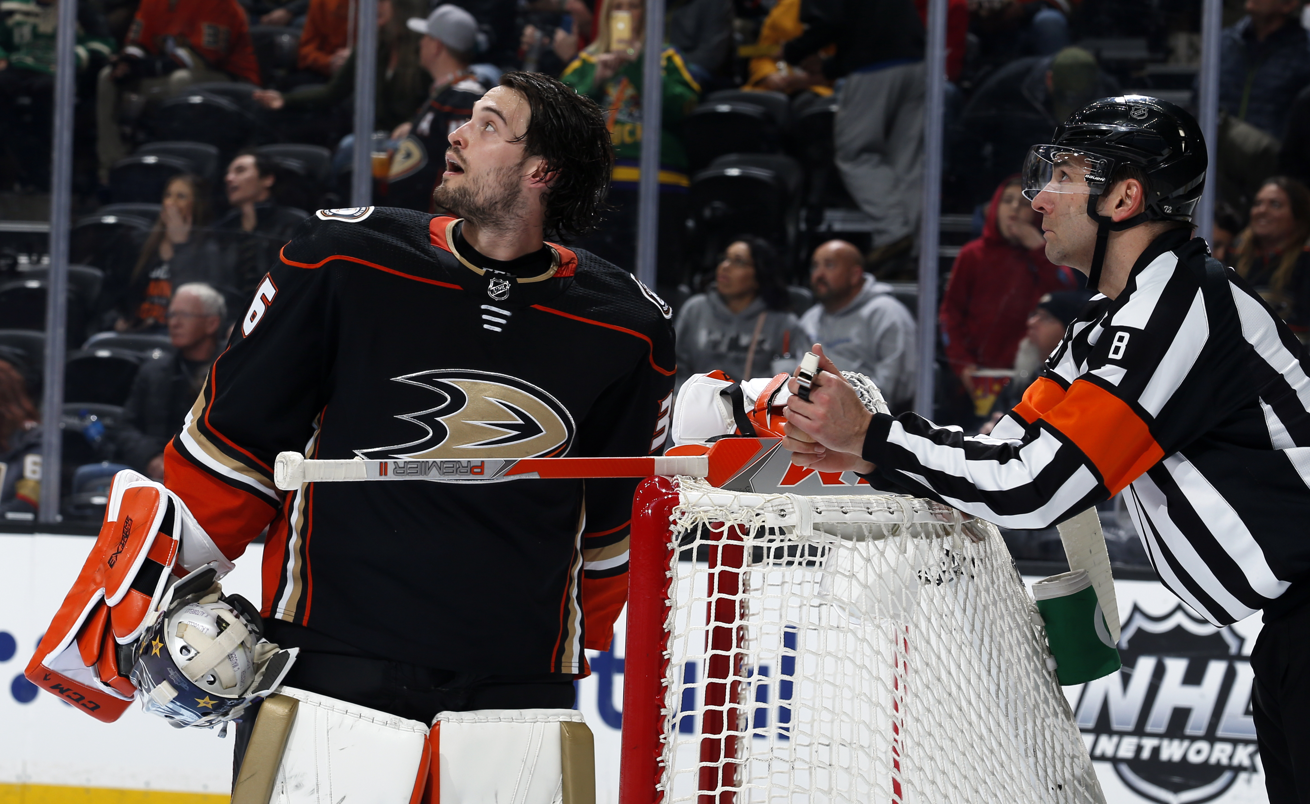 ANAHEIM, CA - FEBRUARY 23: John Gibson #36 of the Anaheim Ducks watches a replay with referee Dave Jackson #8 during the game against the Vegas Golden Knights at Honda Center on February 23, 2020 in Anaheim, California.