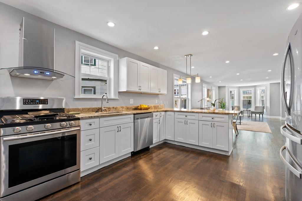 A new, sunny kitchen with an L-shaped counter.