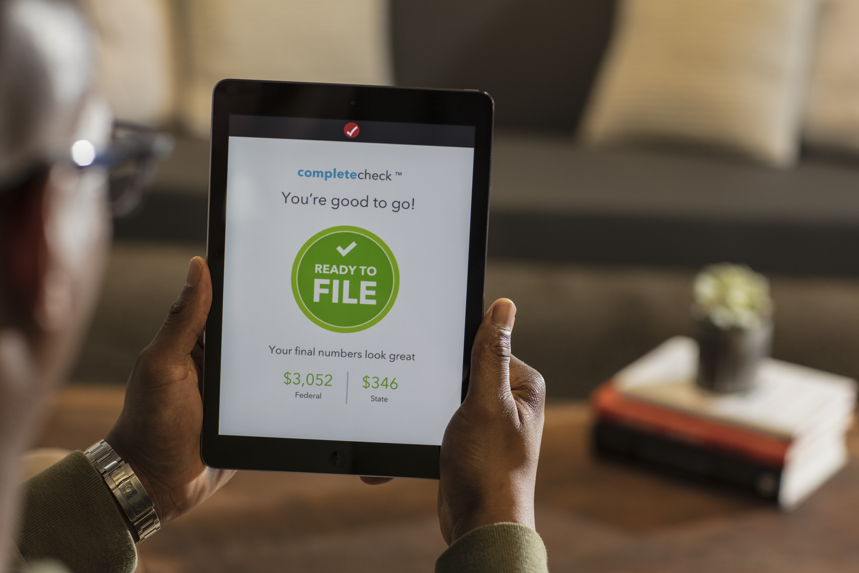 TurboTax is displayed on a tablet.