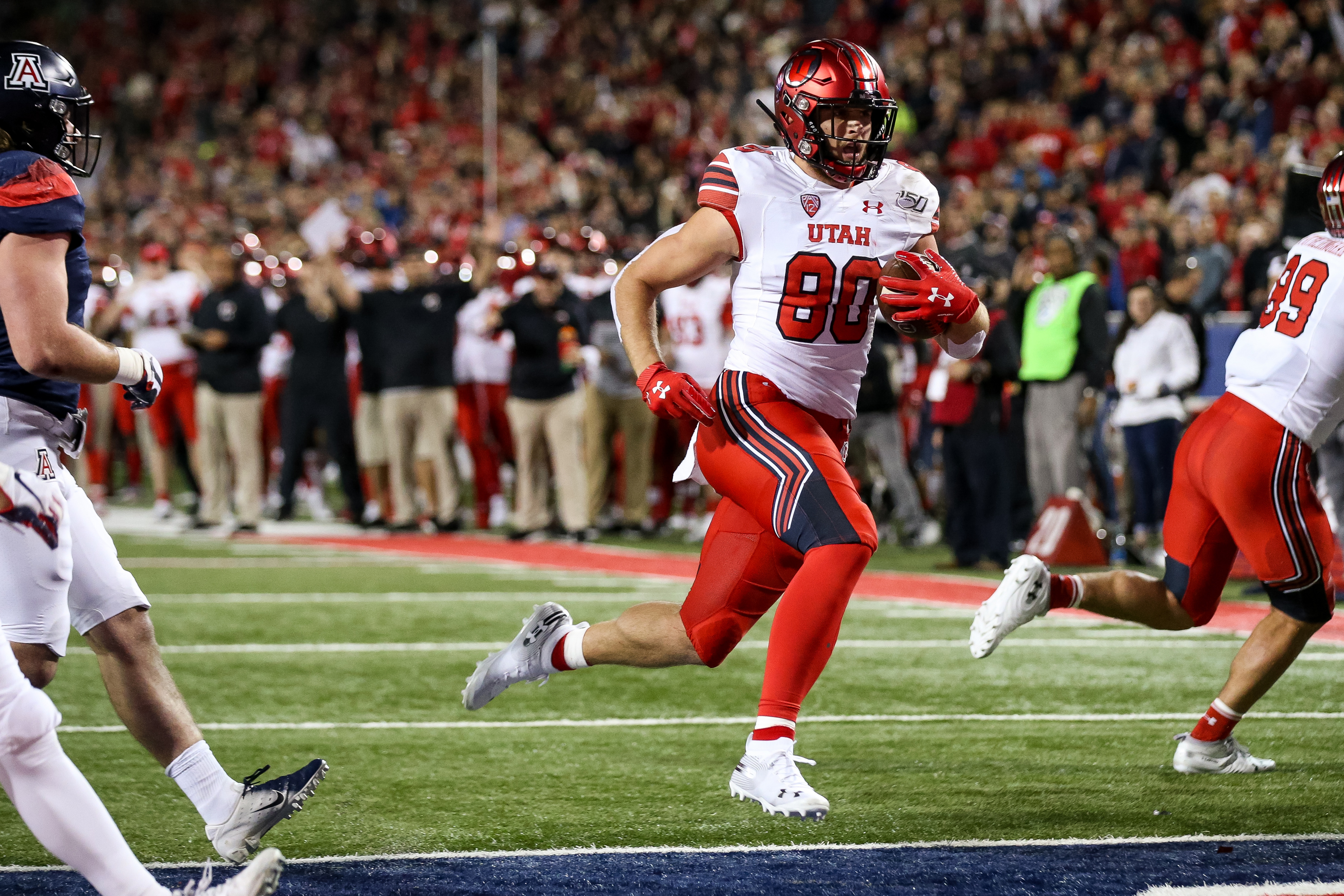 Utah Utes tight end Brant Kuithe (80) runs the ball in for a touchdown, putting the Utes up 7-0 over the Arizona Wildcats after the PAT, at Arizona Stadium in Tucson, Arizona on Saturday, Nov. 23, 2019.
