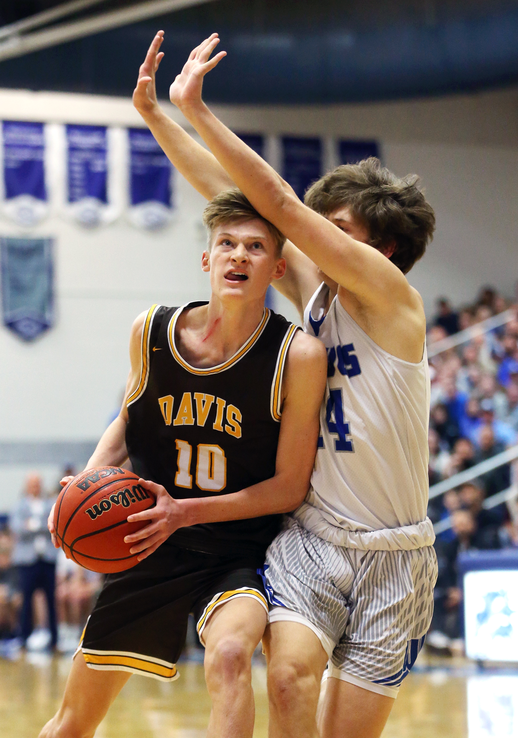 Davis' Trevan Leonhardt drives to the hoop with Fremont's Dakota Argyle defending as the two teams play in a high school basketball game in Plain City on Friday, Jan. 3, 2020. Davis won 85-74.