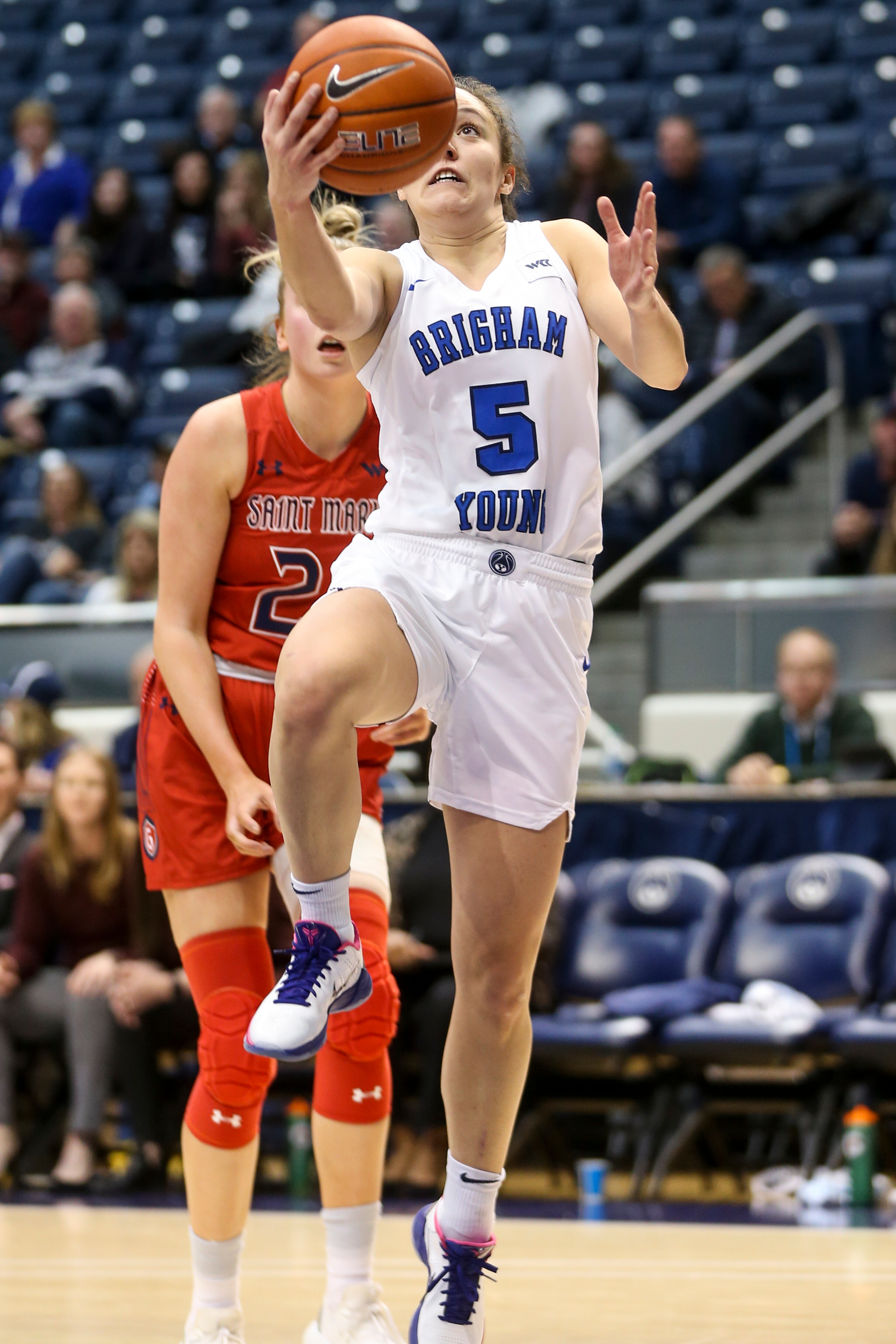 BYU Cougars guard Maria Albiero (5) goes for a layup against the Saint Mary's Gaels at the Marriott Center in Provo on Thursday, Feb. 13, 2020.