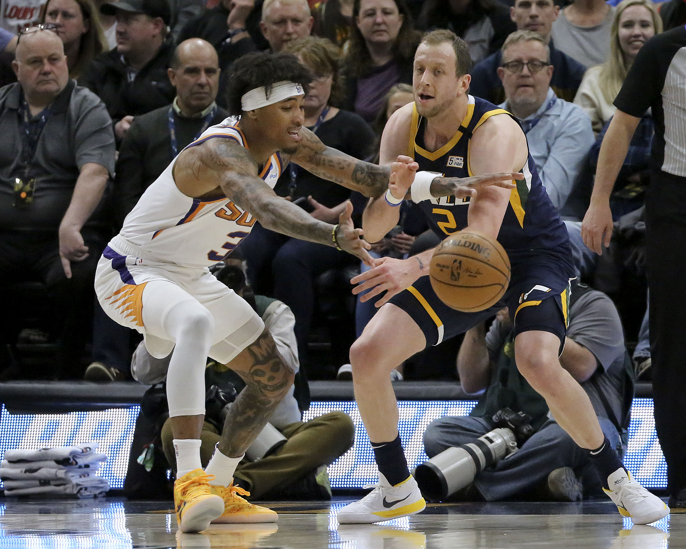 Phoenix Suns forward Kelly Oubre Jr. (3) and Utah Jazz guard Joe Ingles (2) fight for the ball during an NBA game at the Vivint Smart Home Arena in Salt Lake City on Monday, Feb. 24, 2020.