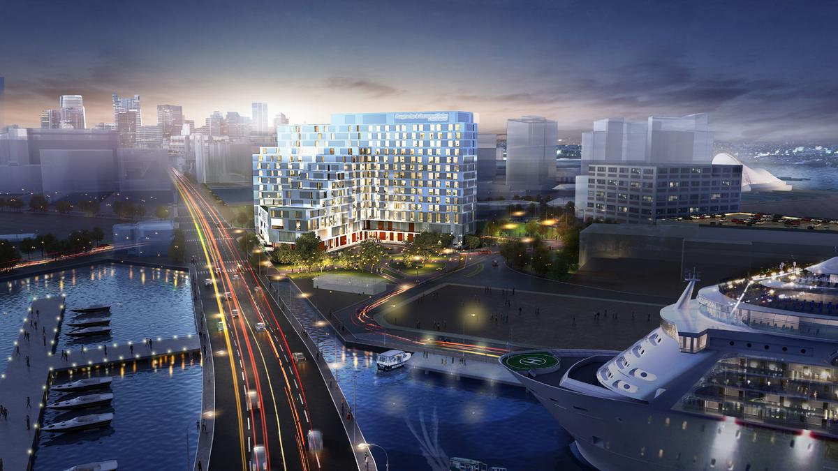 Rendering of a multi-story hotel complex on a waterfront, with a highway zipping through.