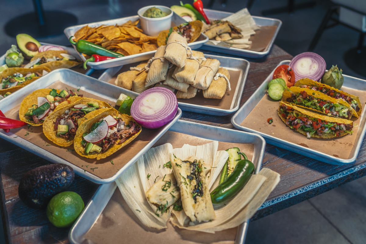 An array of tacos, tamales, and guacamole
