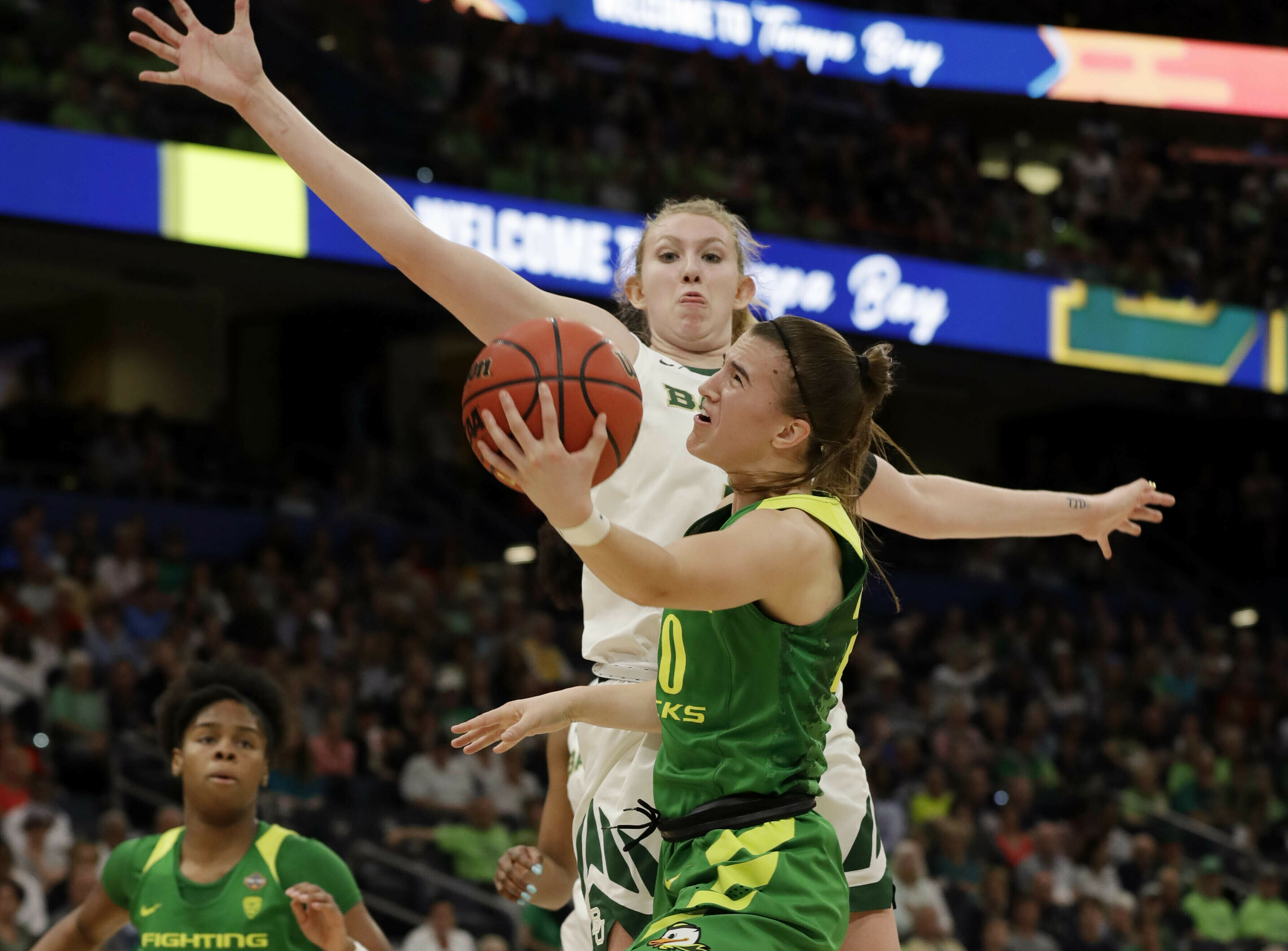 Oregon guard Sabrina Ionescu (20) drives to the basket as Baylor forward Lauren Cox (15), defends during a Final Four semifinal of the NCAA women's college basketball tournament Friday, April 5, 2019, in Tampa, Fla. (AP Photo/Chris O'Meara)