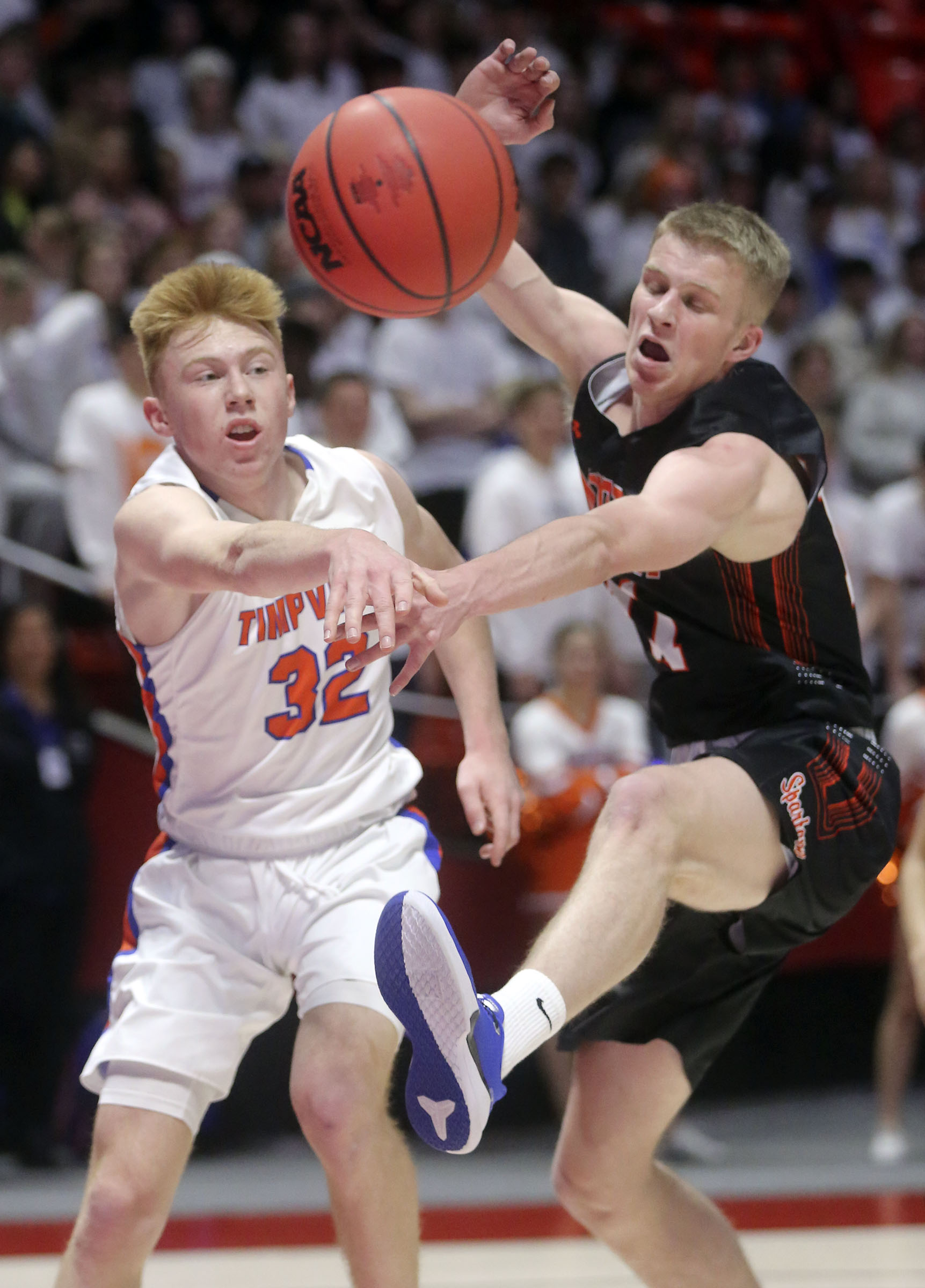 Timpview's Coleman Ford passes the ball around Murray's Jacob Pollei during the 5A boys basketball quarterfinals at the Huntsman Center in Salt Lake City on Tuesday, Feb. 25, 2020. Timpview won 53-32.