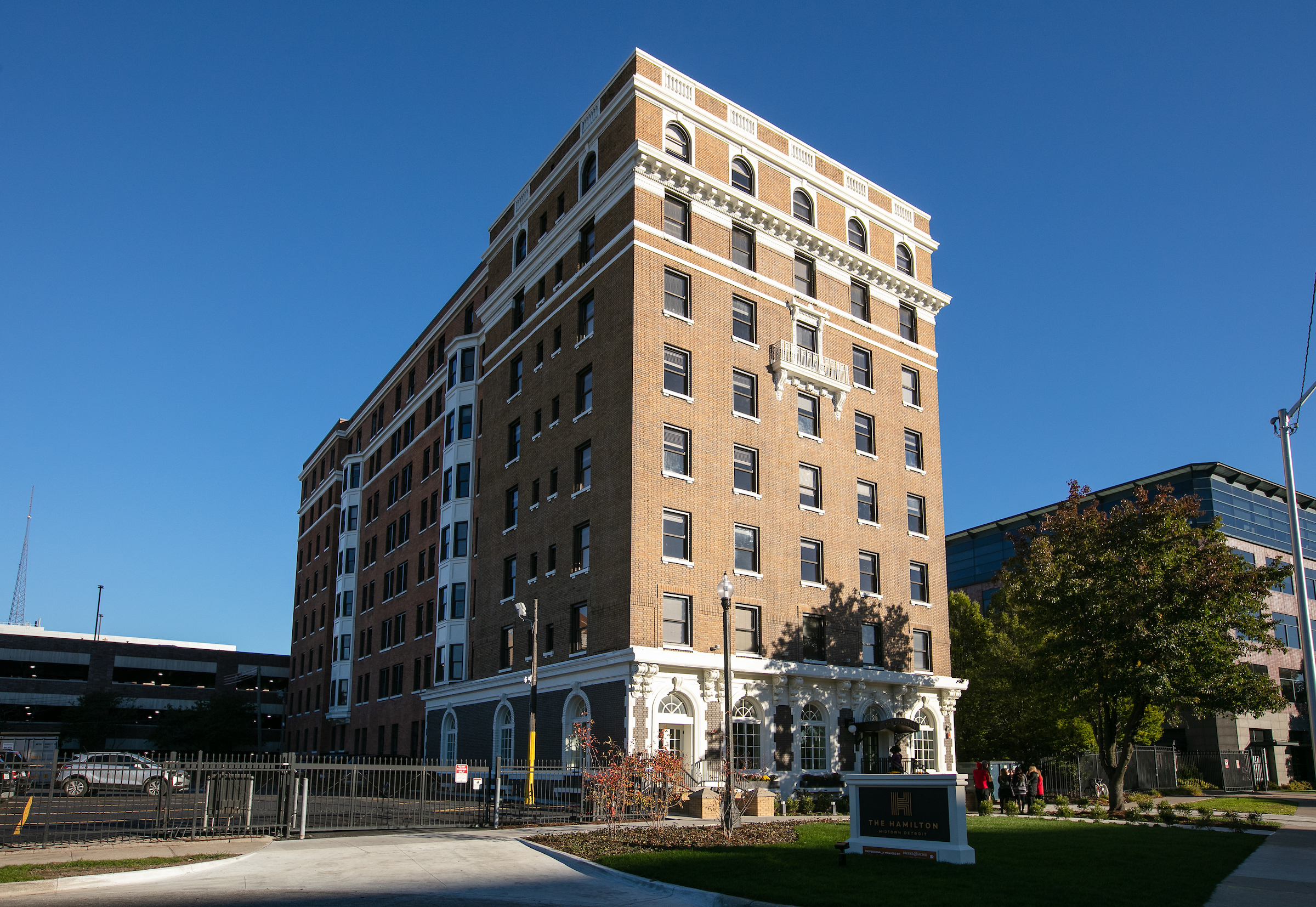 A multi-story rectangular brick building with a cul-de-sac in front.