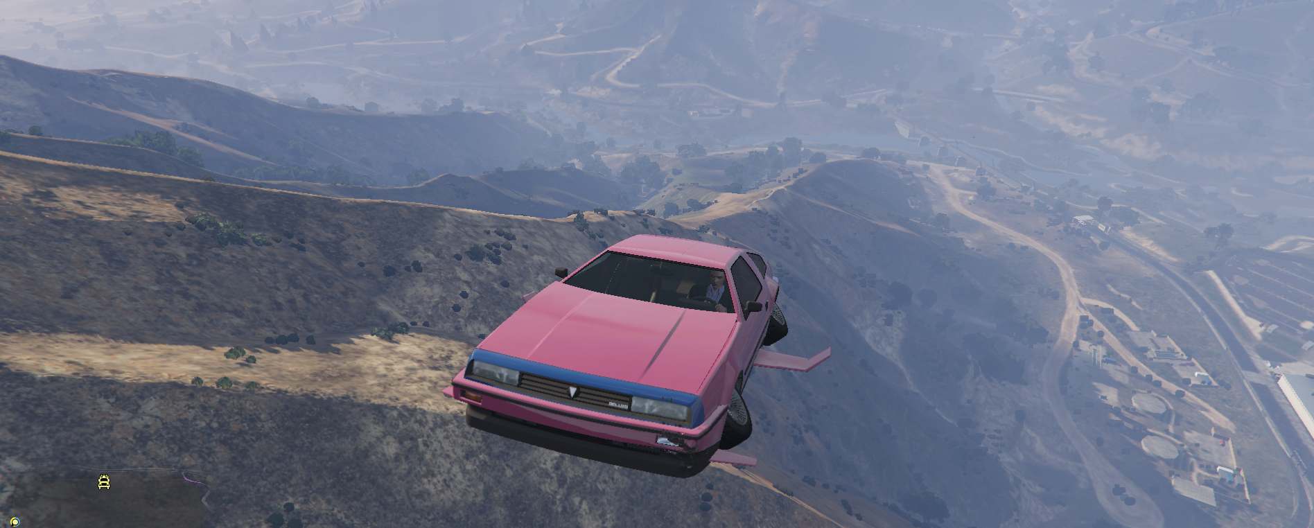 Grand Theft Auto Online - a pink Deluxo takes to the skies over mountains