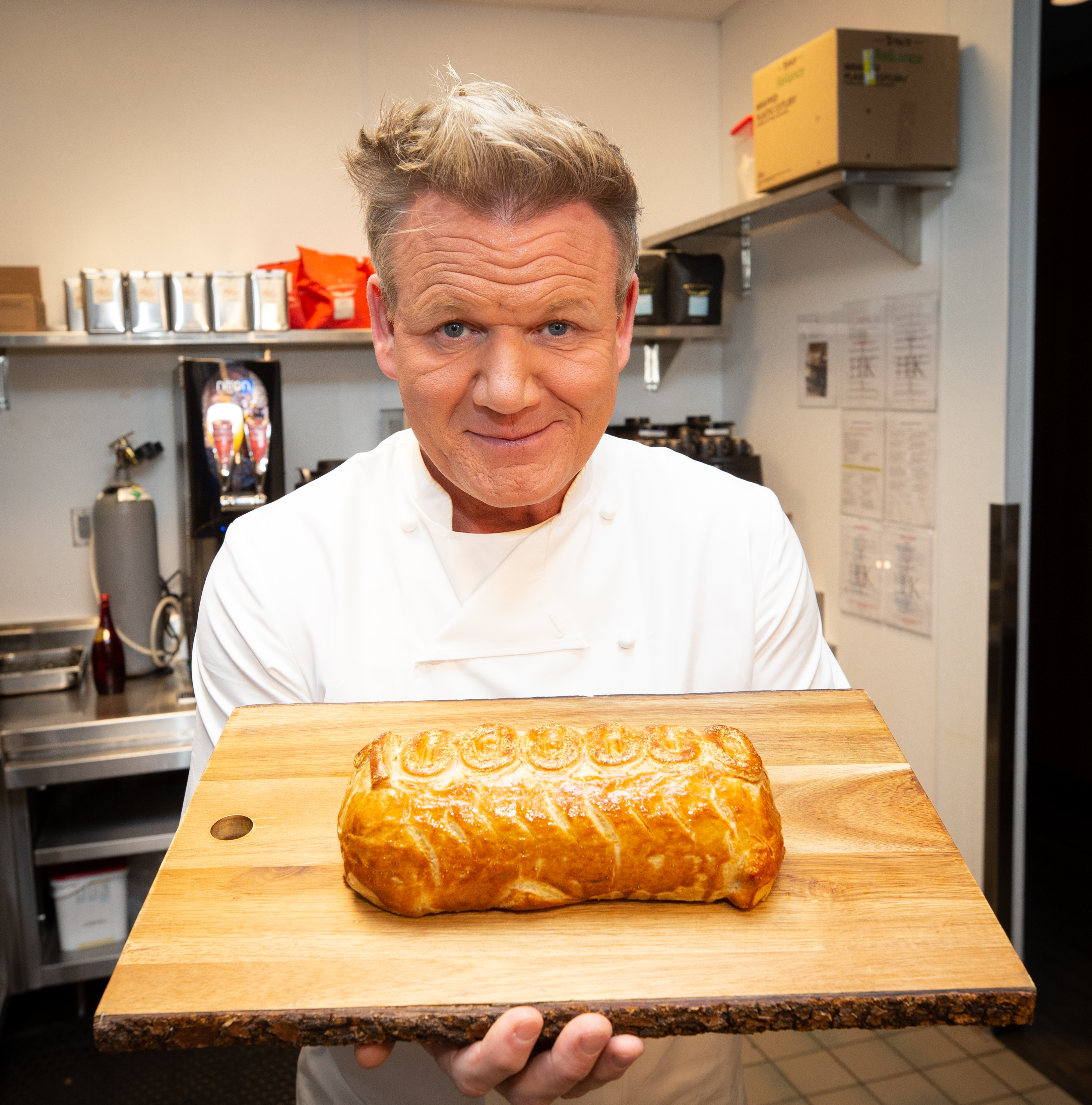 A chef holds a beef Wellington